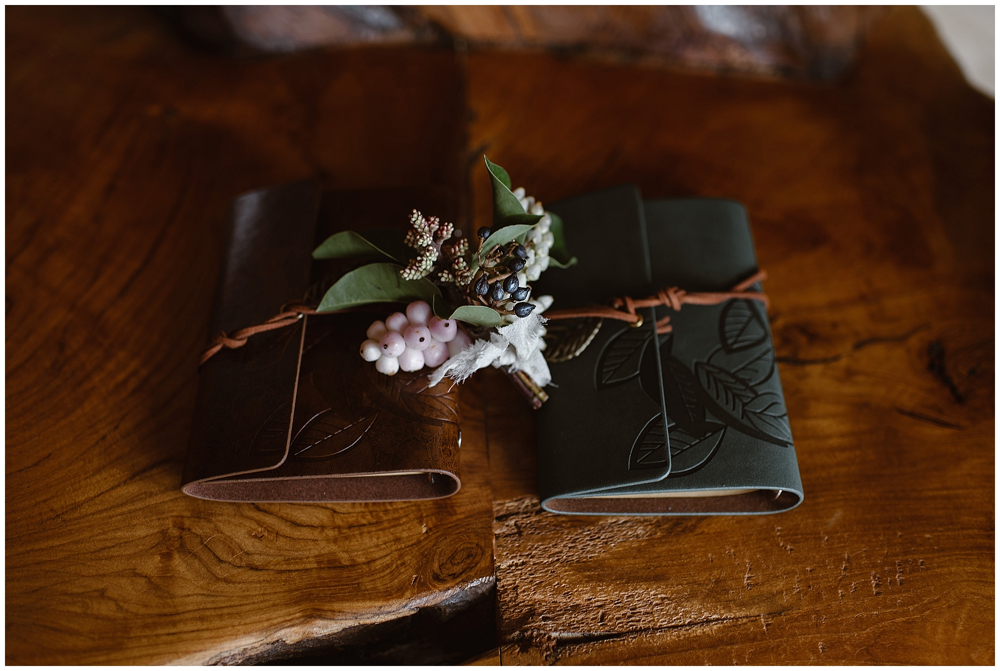 Marlayna and Austin handwrote their vows to each other in leather bound notebooks for their snowy winter elopement ceremony. Photo by Adventure Instead, Maddie Mae Elopement Photographers.