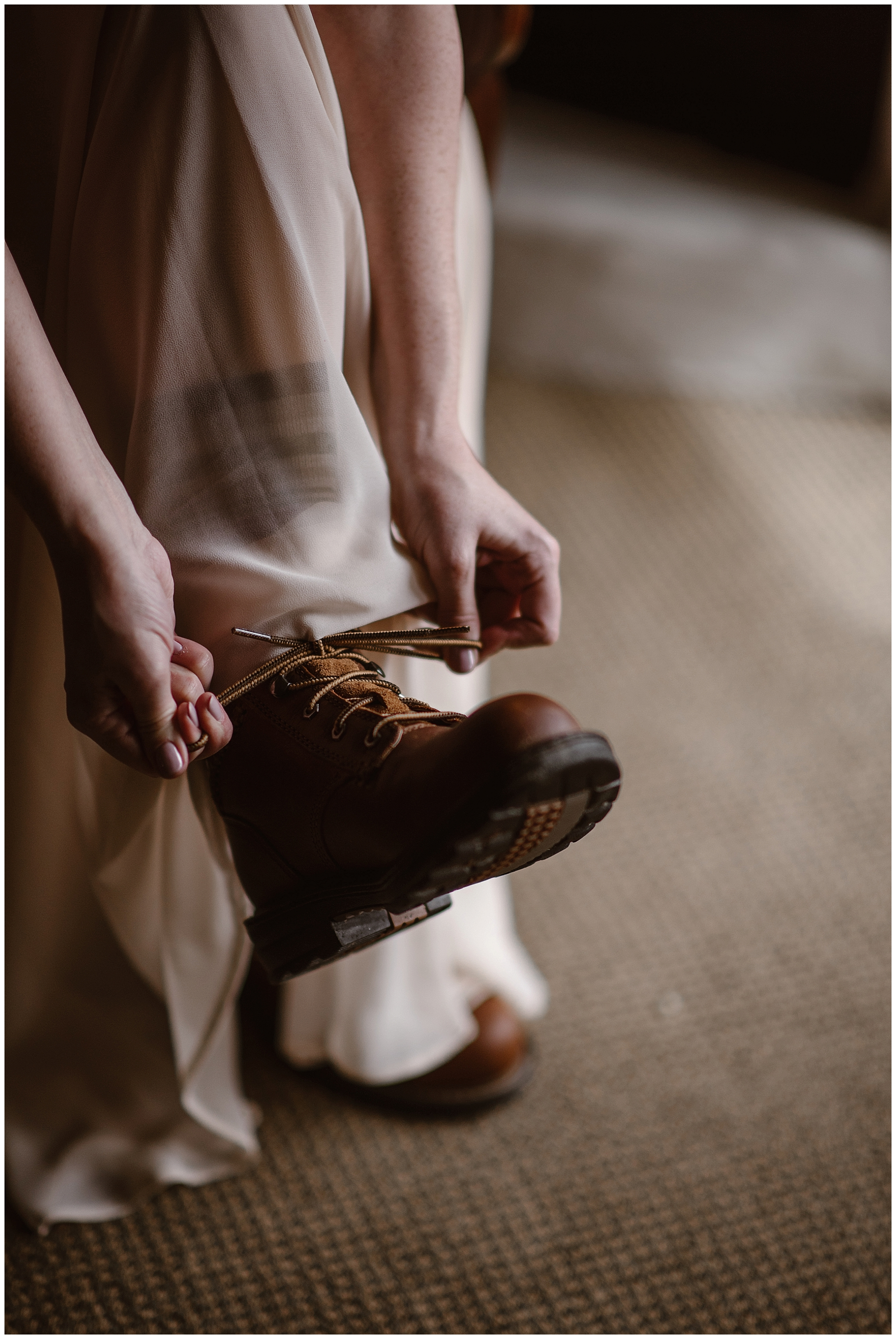 Hiking boots are essential for a winter elopement ceremony. Marlayna layers up for her outdoor elopement at Sapphire Point in Dillon, Colorado. Photo by Adventure Instead, Maddie Mae Elopement Photographers.