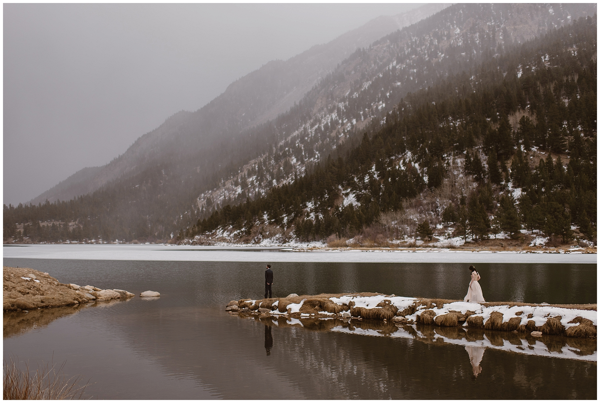 Marlayna and Austin chose to have their first look at Georgetown Lake outside Georgetown, Colorado with the snowy mountain peaks behind them. Photo by Adventure Instead, Maddie Mae Elopement Photographers.