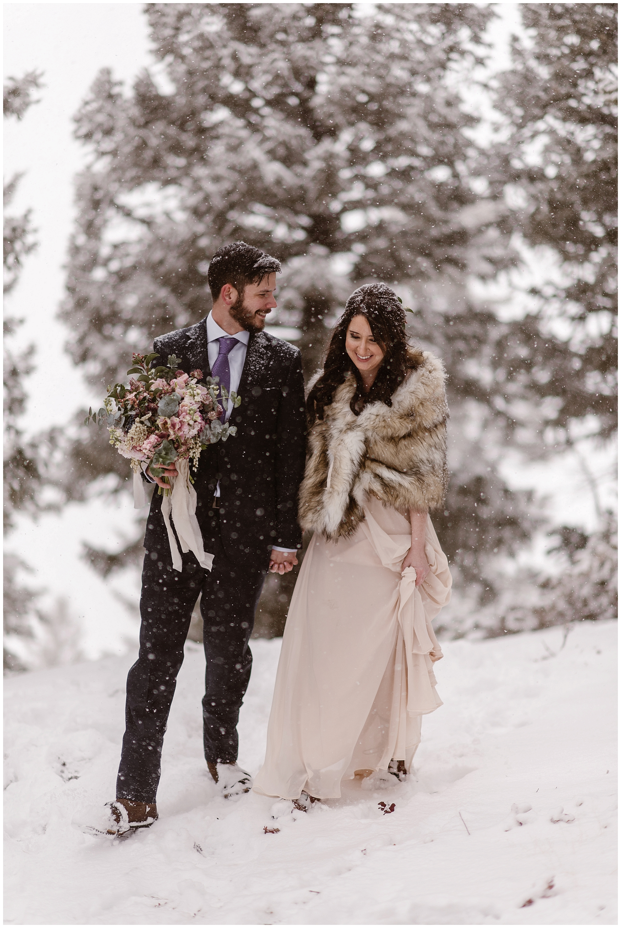 Sapphire Point in Dillon, Colorado look like a scene out of a snow globe for Marlayna and Austin's snowy winter elopement. Photo by Adventure Instead, Maddie Mae Elopement Photographers.