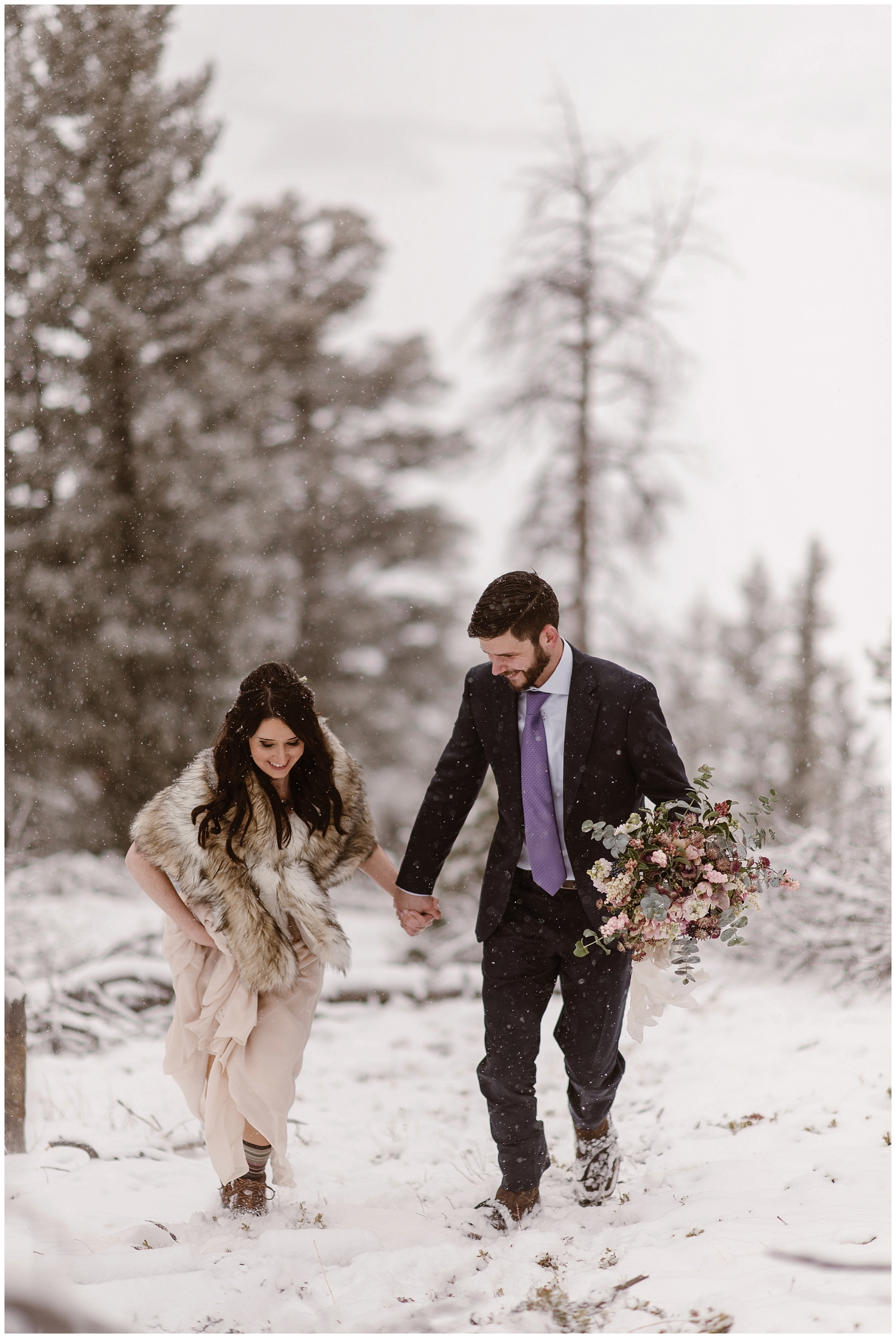 Marlayna and Austin eloped in a scene that looked like a snow globe. Snow fell during their winter elopement at Sapphire Point in Dillon, Colorado. Photo by Adventure Instead, Maddie Mae Elopement Photographers.