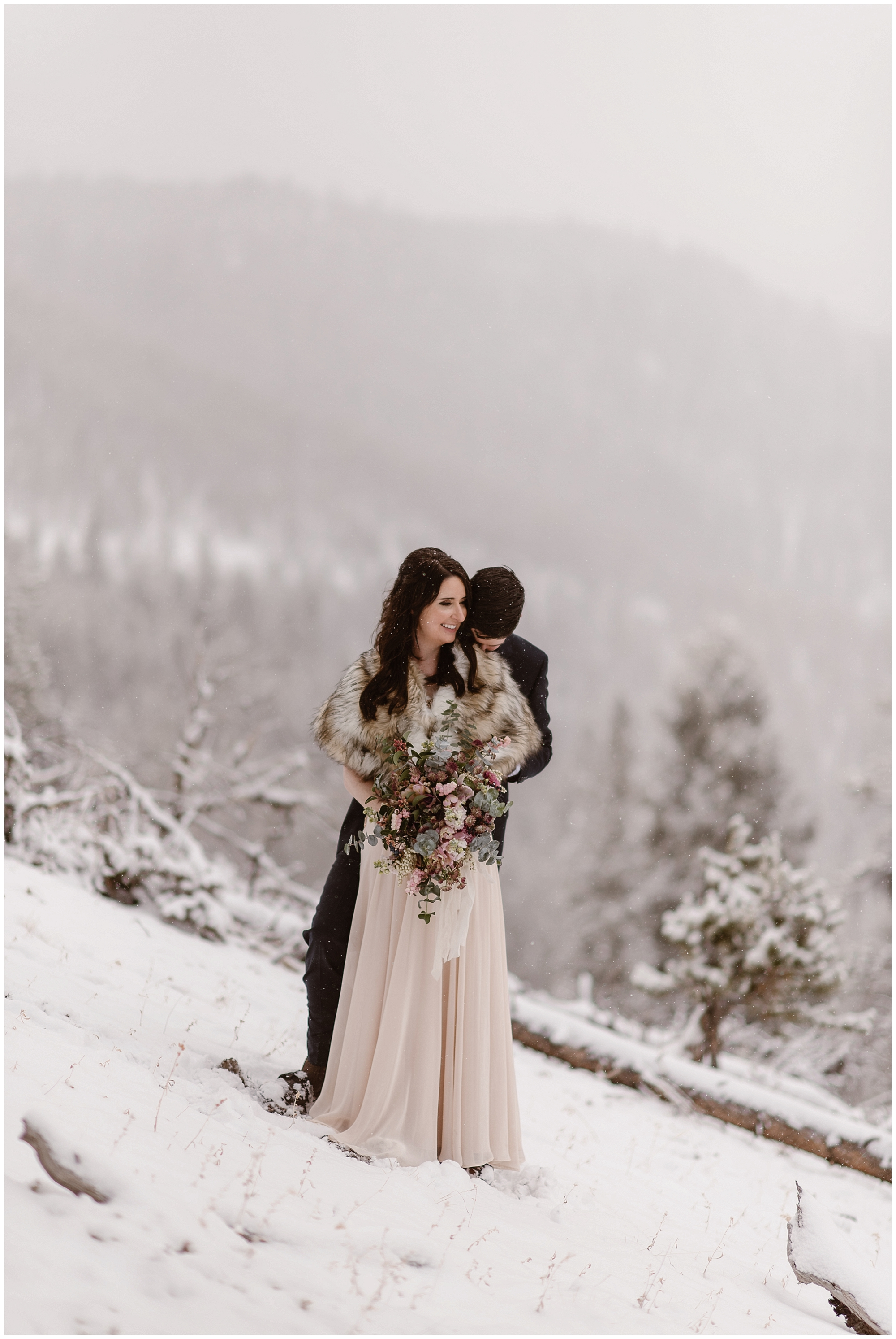 Marlayna and Austin embrace before their snowy winter elopement ceremony. They chose to self solemnize their wedding and travel to Colorado to get married. Photo by Adventure Instead, Maddie Mae Elopement Photographers.