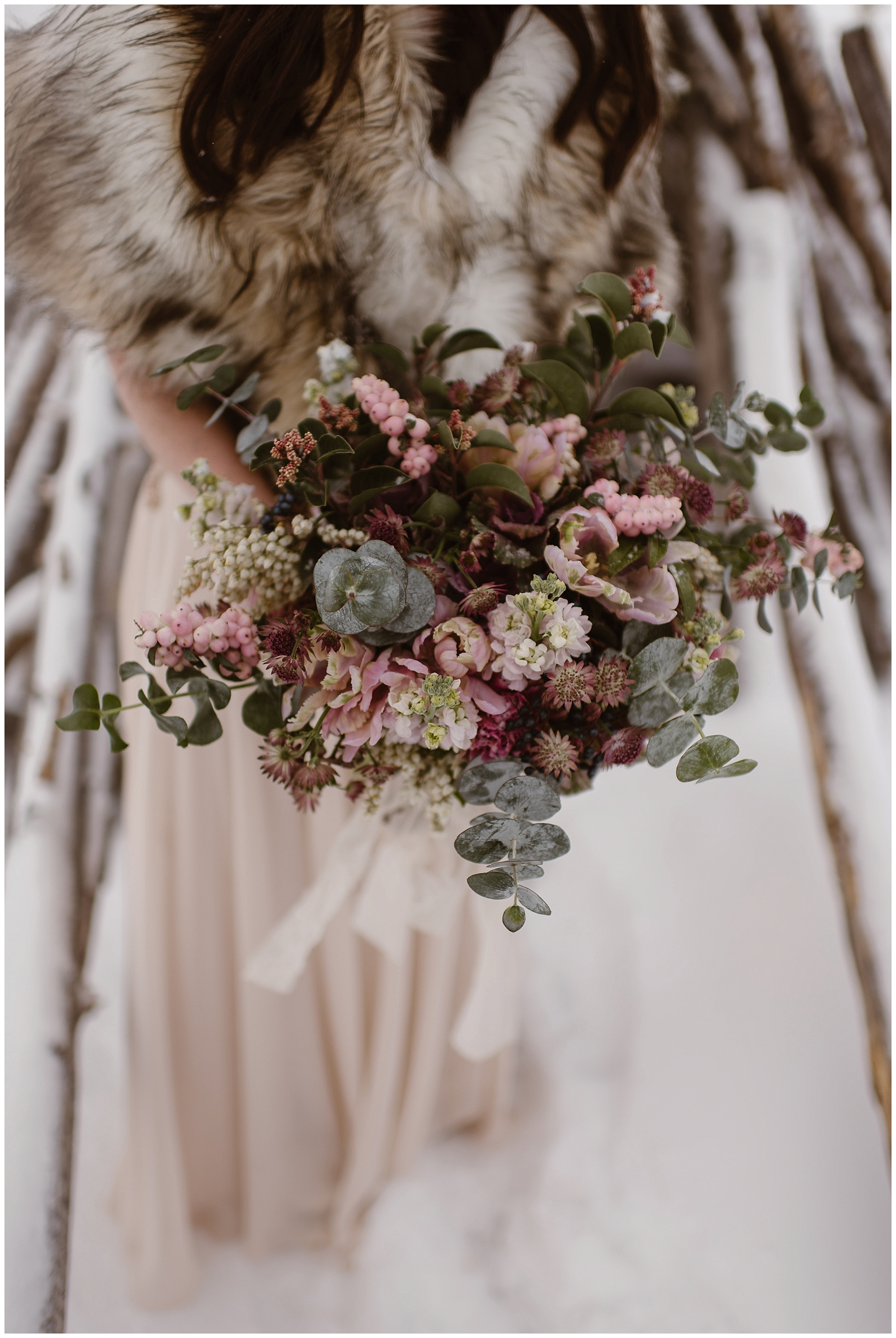 Marlayna's big beautiful bridal bouquet was so beautiful against the snowy backdrop of Sapphire Point in Dillon, Colorado. Photo by Adventure Instead, Maddie Mae Elopement Photographers.