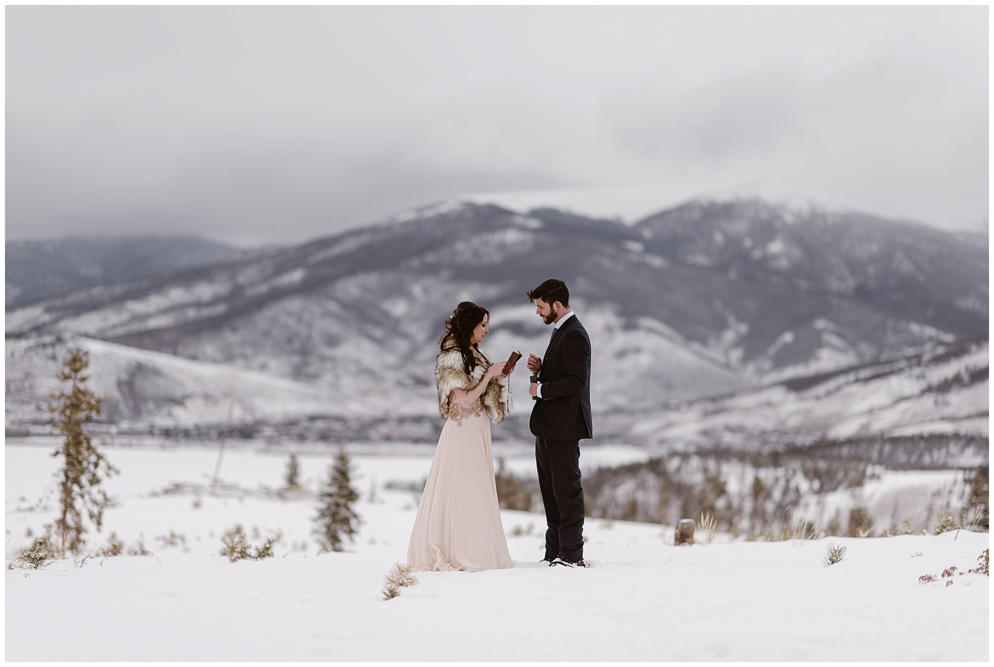 With the snow capped Rocky Mountains behind them, Marlayna and Austin had a self solemnizing ceremony at Sapphire Point in Dillon, Colorado. Photo by Adventure Instead, Maddie Mae Elopement Photographers.