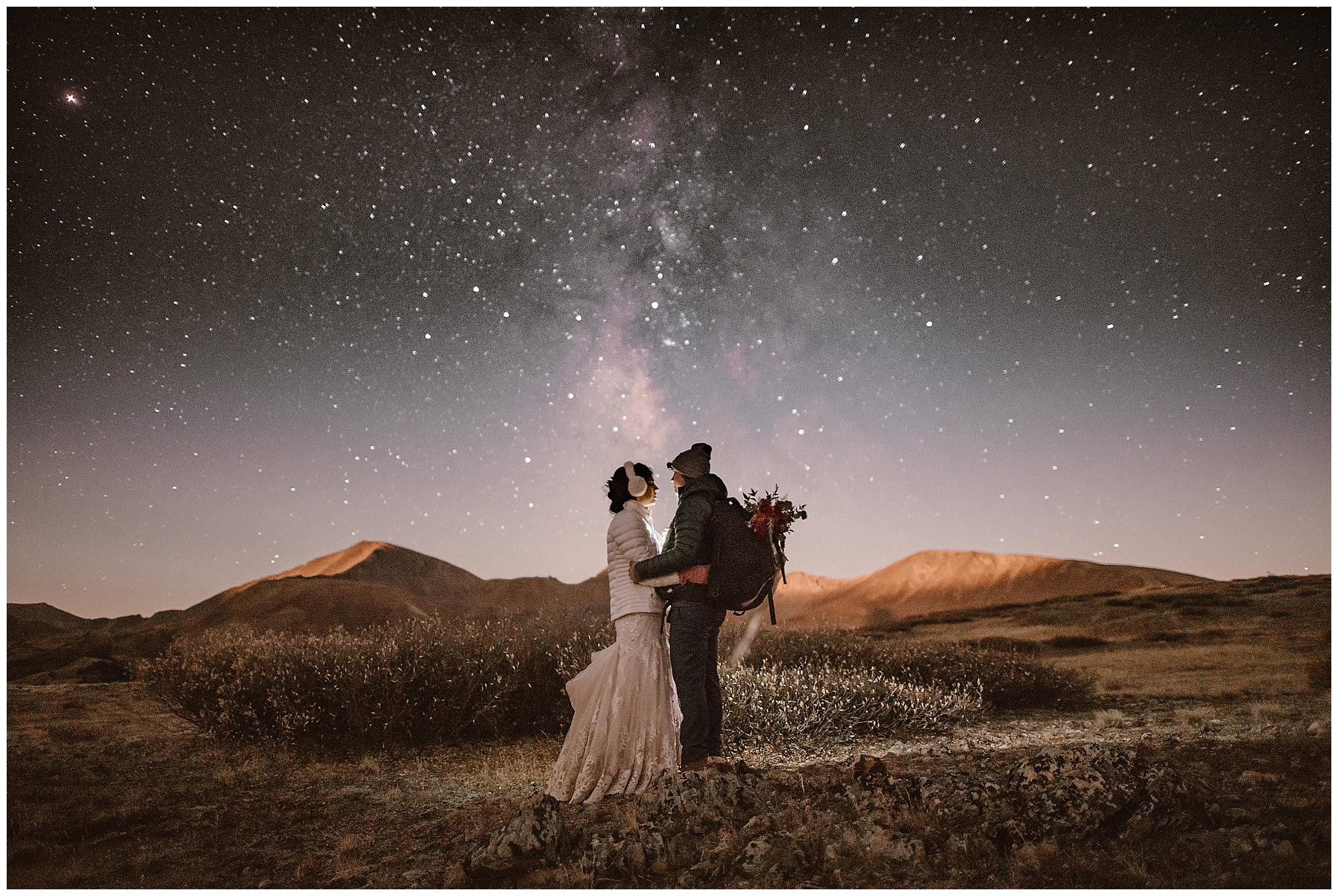 For winter elopements, make sure you dress in layers and take frequent breaks to stay warm. Stay out after the sun goes down at your hiking elopement and you'll get stunning images of the Milky Way Galaxy. This image was also selected to Junebug Wedding's top 50 Best Wedding Photos in the World! Where you elope and how you say your vows matters! Photo by Maddie Mae, Adventure Instead Elopement Photographers.