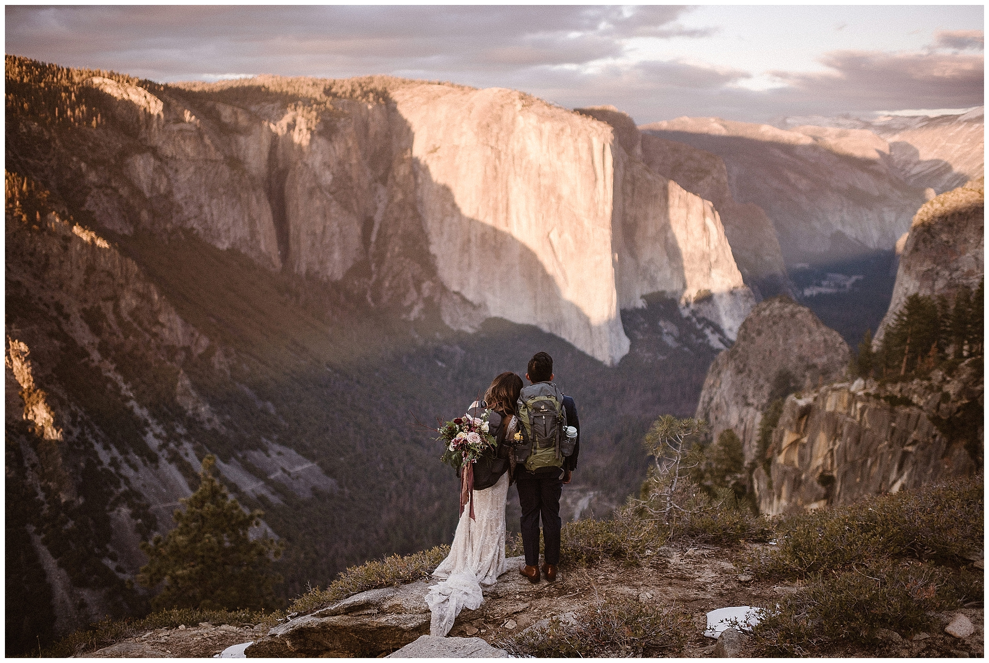Hike in your wedding clothes and have an adventure on your elopement day! This couple chose to look out over Yosemite Valley in Yosemite National Park for their adventure elopement day. Photo by Maddie Mae, Adventure Instead Elopement Photographers.