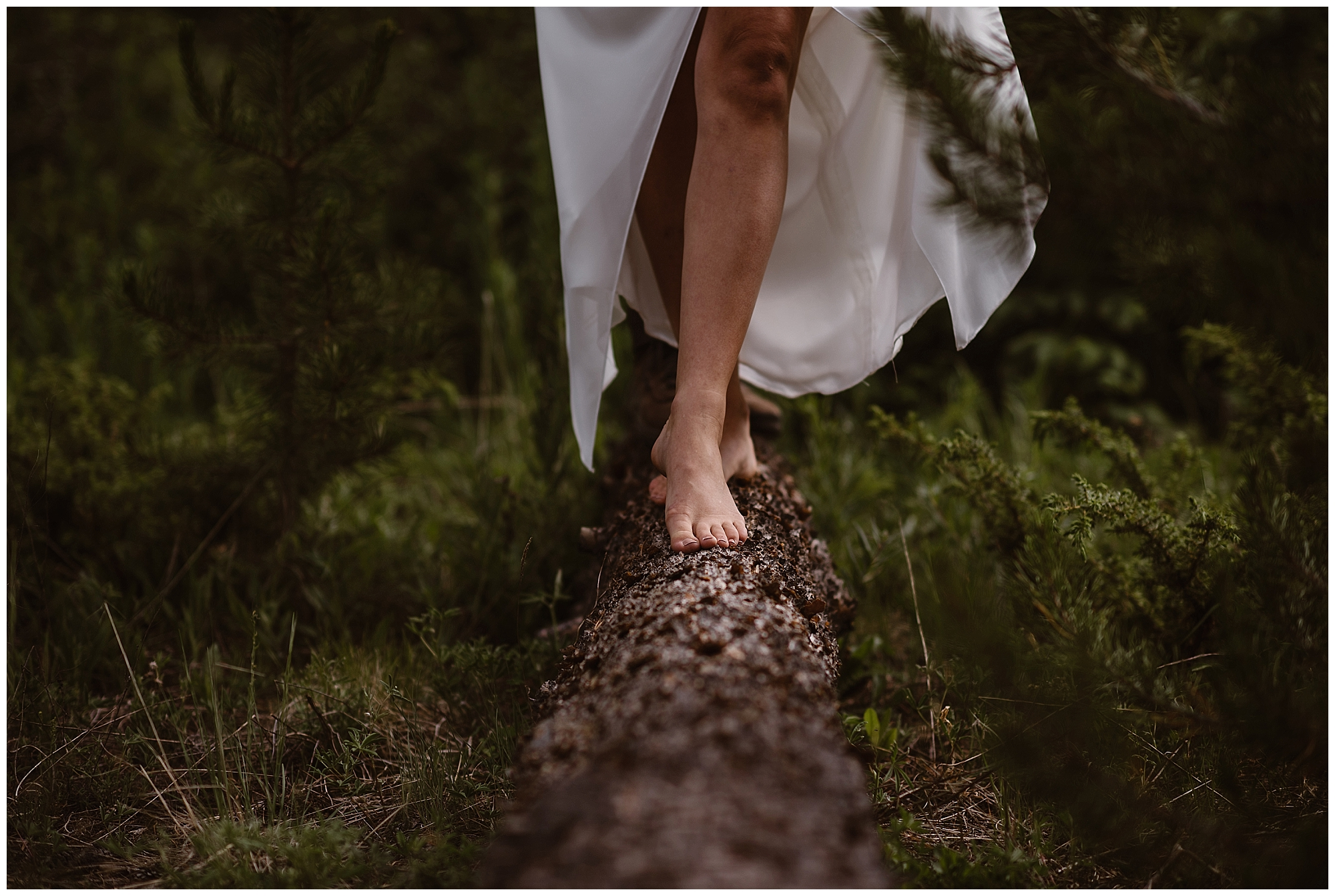 A bride walks through a forest barefoot during her elopement ceremony. Where you elope and how you say your vows matters! Photo by Maddie Mae, Adventure Instead Elopement Photographers.