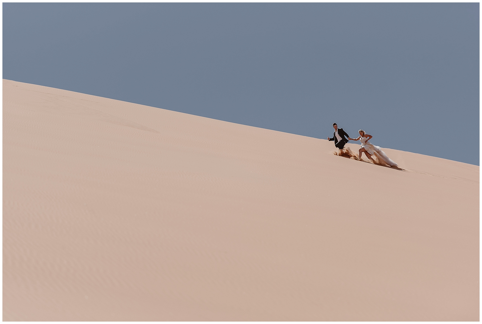 Embrace adventure on your wedding day! Where you elope and how you say your vows matters! This couple chose to elope in the deserts of Namibia, Africa. Photo by Maddie Mae, Adventure Instead Elopement Photographers.