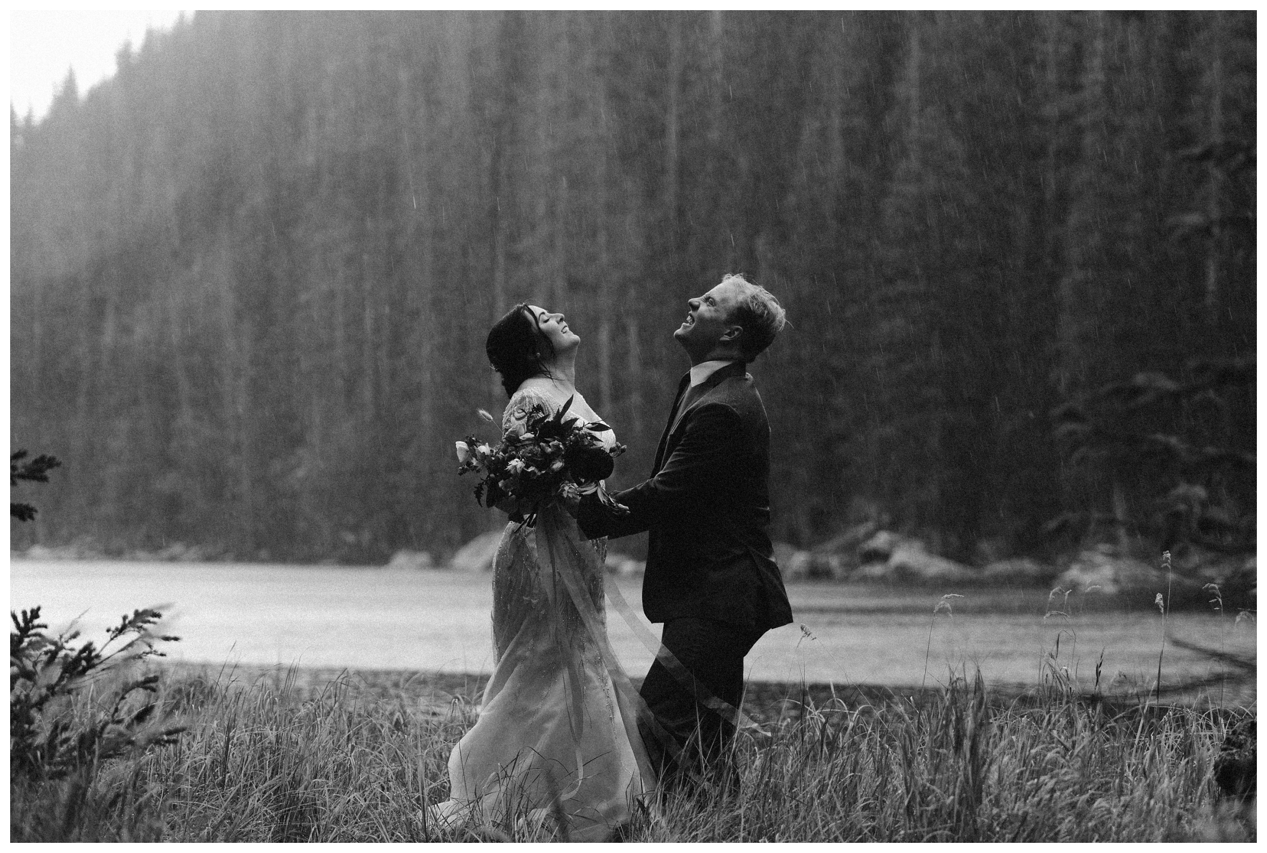 No matter what happens on your elopement wedding day, it's your day! Embrace the adventure, like this couple who's elopement day featured an epic summer thunderstorm. Photo by Maddie Mae, Adventure Instead Elopement Photographers.