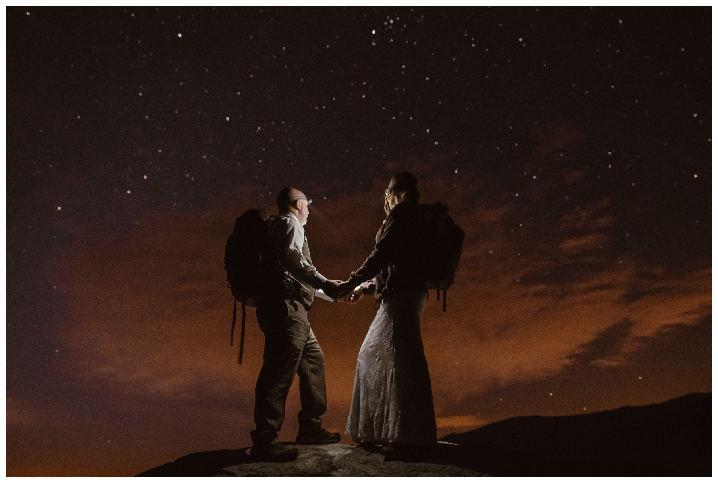 We believe in capturing your entire elopement day, from start to finish. This couple chose to elope on a mountain and hiked down in the dark after which resulted in this epic starry night sky shot from their elopement day. Photo by Maddie Mae, Adventure Instead Elopement Photographers.
