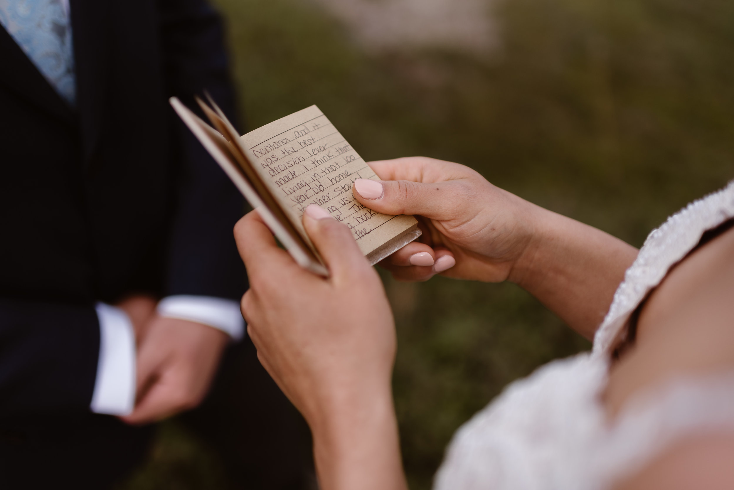 This close-up shot taken by Alaska wedding photographers Adventure Instead shows the bride holding her vow book. The words inside the vow book express that the decisions leading up to meeting Connor were the best of her life.