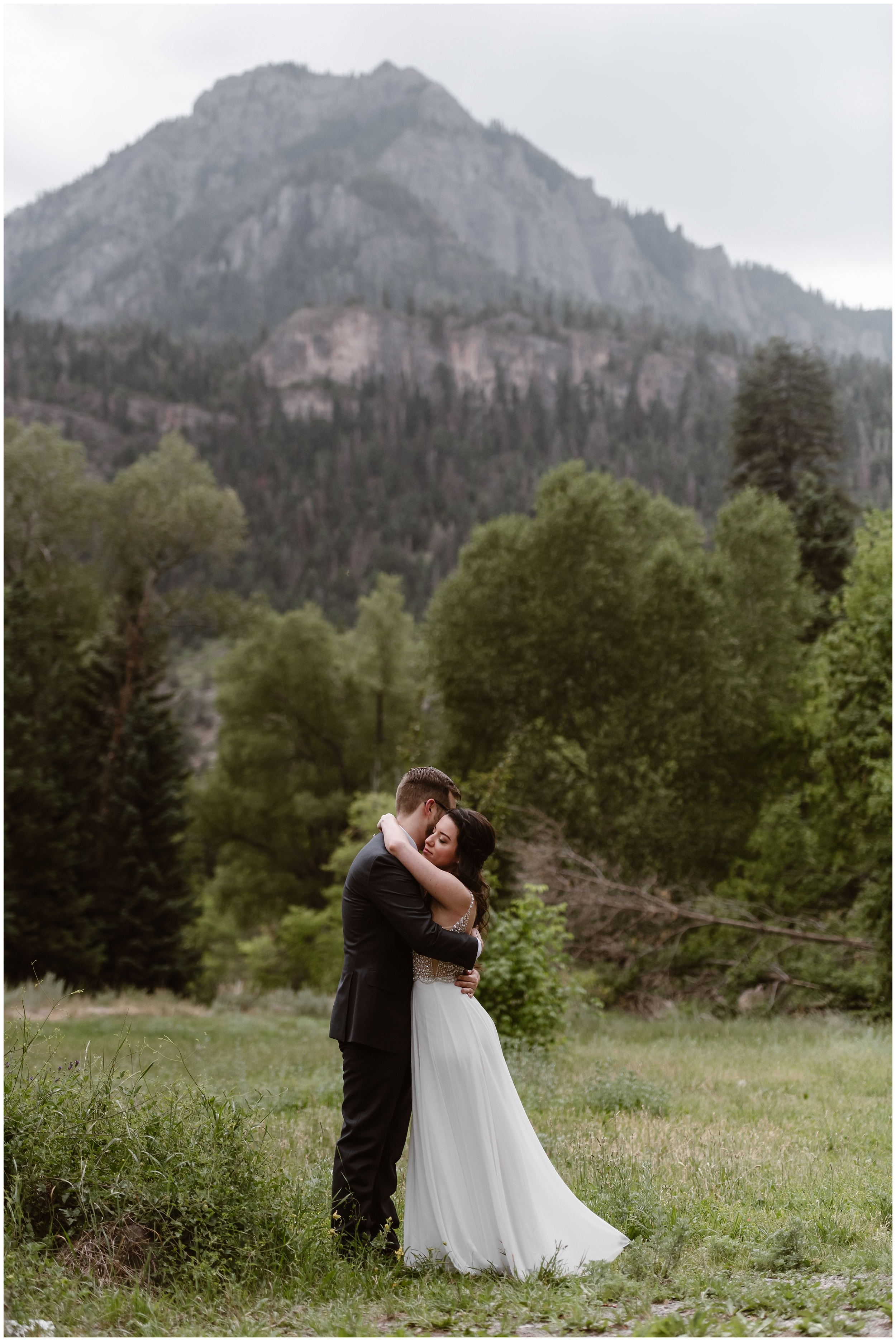 Katie and Logan, the bride and the groom, embrace sweetly moments after their first look ceremony, which is one of the unique eloping ideas that many couples choose as part of their small simple wedding. These adventure elopement photos, as well as their 4x4 wedding photos, were captured by adventure wedding photographer Adventure Instead.