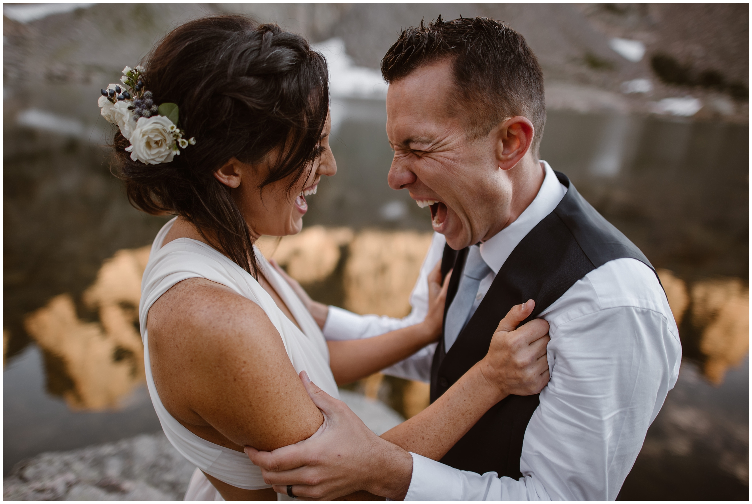 A bride and groom, just finishing their alternative wedding ceremony, grab onto each other and yell excitedly. The bride, smiling and excited, stares are her groom, who's holding onto her and screaming as loud as he can. This non-traditional wedding ceremony was captured by elopement wedding photographer Adventure Instead.