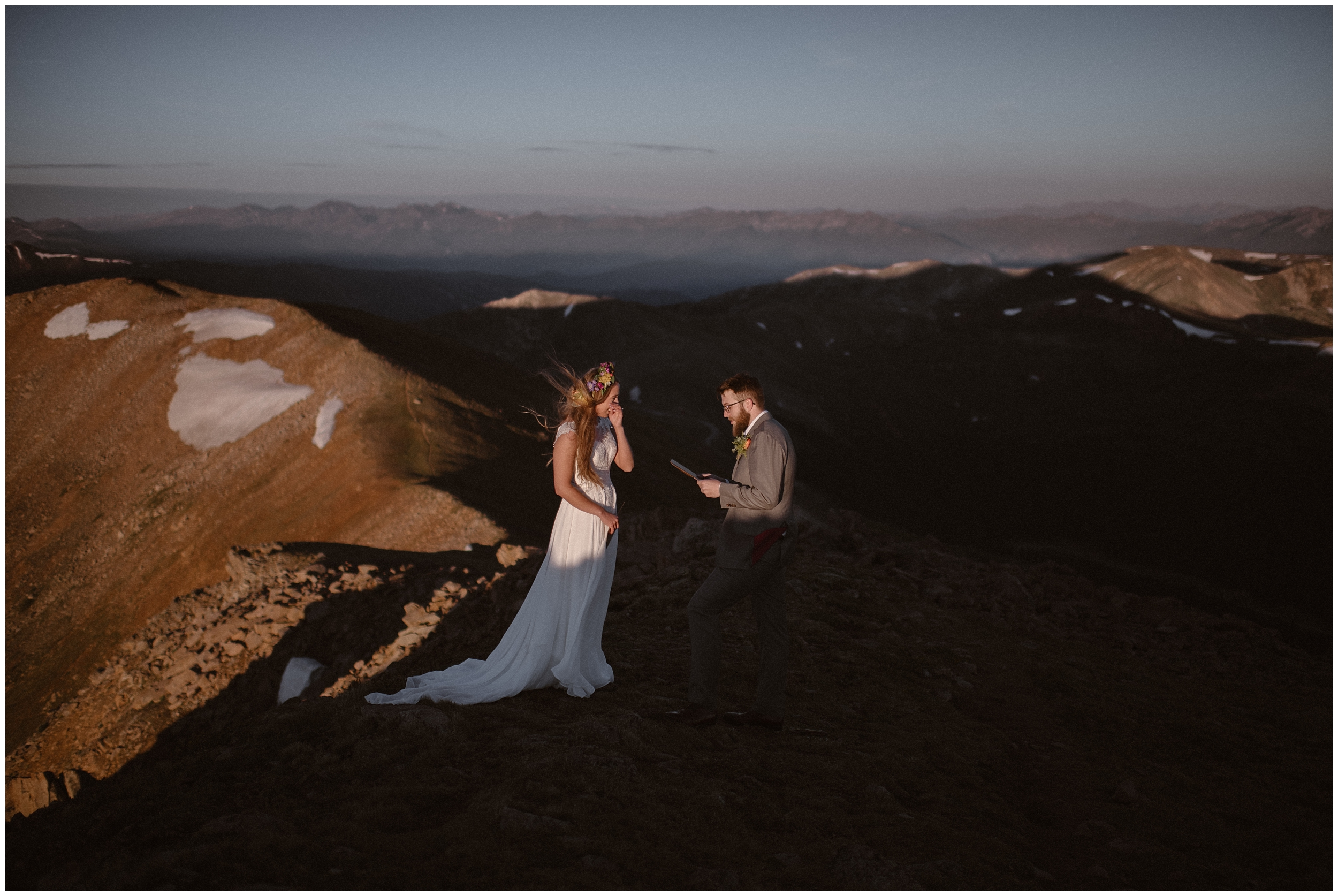 A bride and groom stand on top of an icy mountain during their wedding ceremony. These elopement pictures show some of the benefits of eloping—a secluded spot, the freedom to have a non traditional wedding ceremony, and the freedom to choose if you want to self-solemnize or have a wedding officiant.