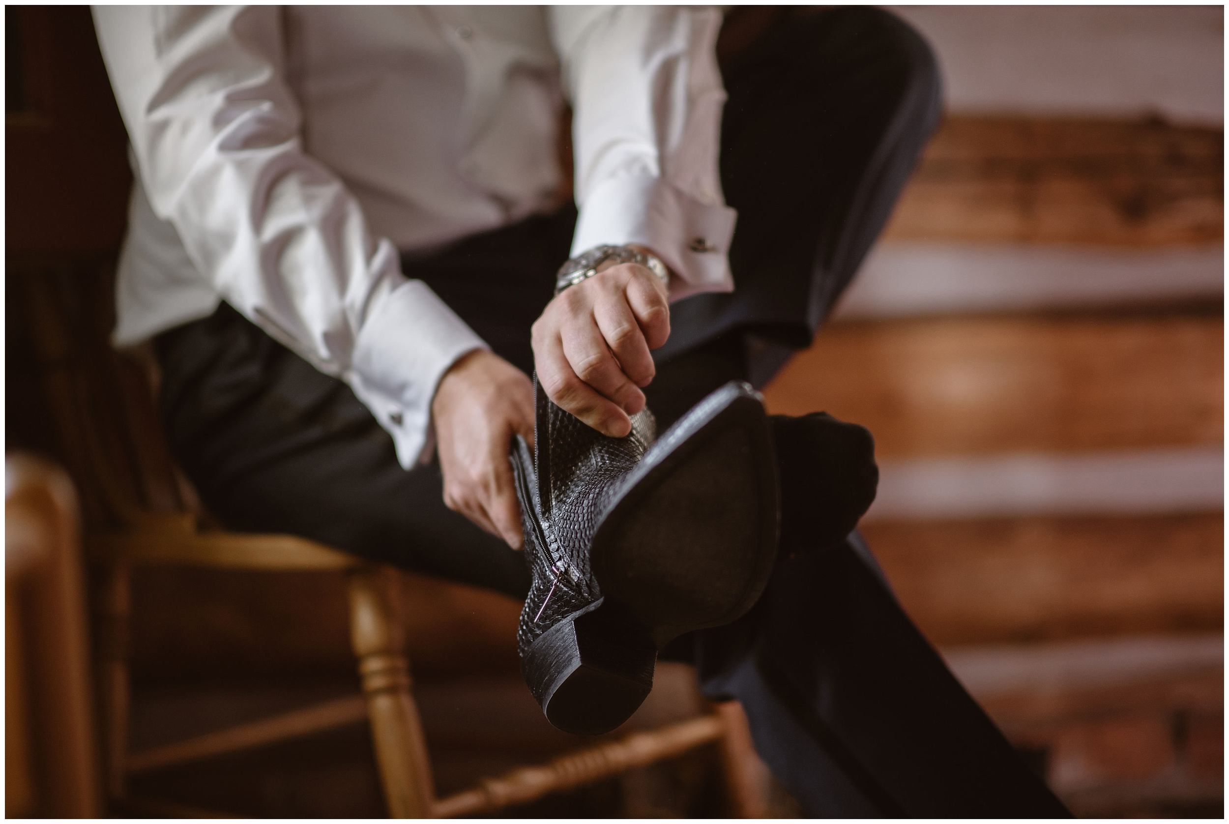 This closeup elopement photo — captured by Adventure Instead, Colorado wedding photographer, shows a groom zipping up his cowboy boots as he gets ready for his Colorado mountain wedding.