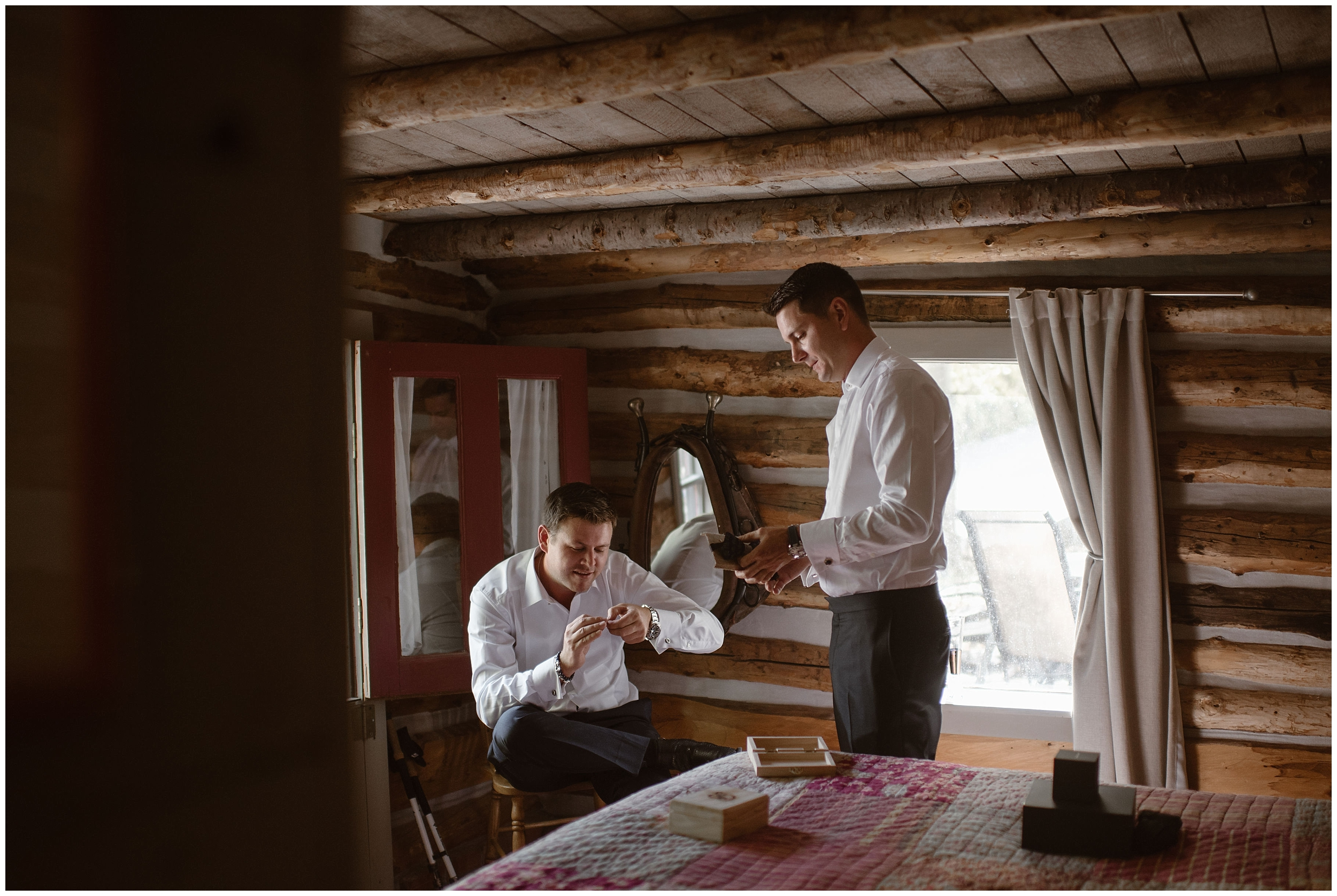The two grooms, Brian and Ernie, take a moment together in their VRBO as they help each other get ready for their Colorado destination wedding. They both decided to include some of their unique eloping ideas by implementing fun details, like their black diamond cuff links, into their elopement pictures.