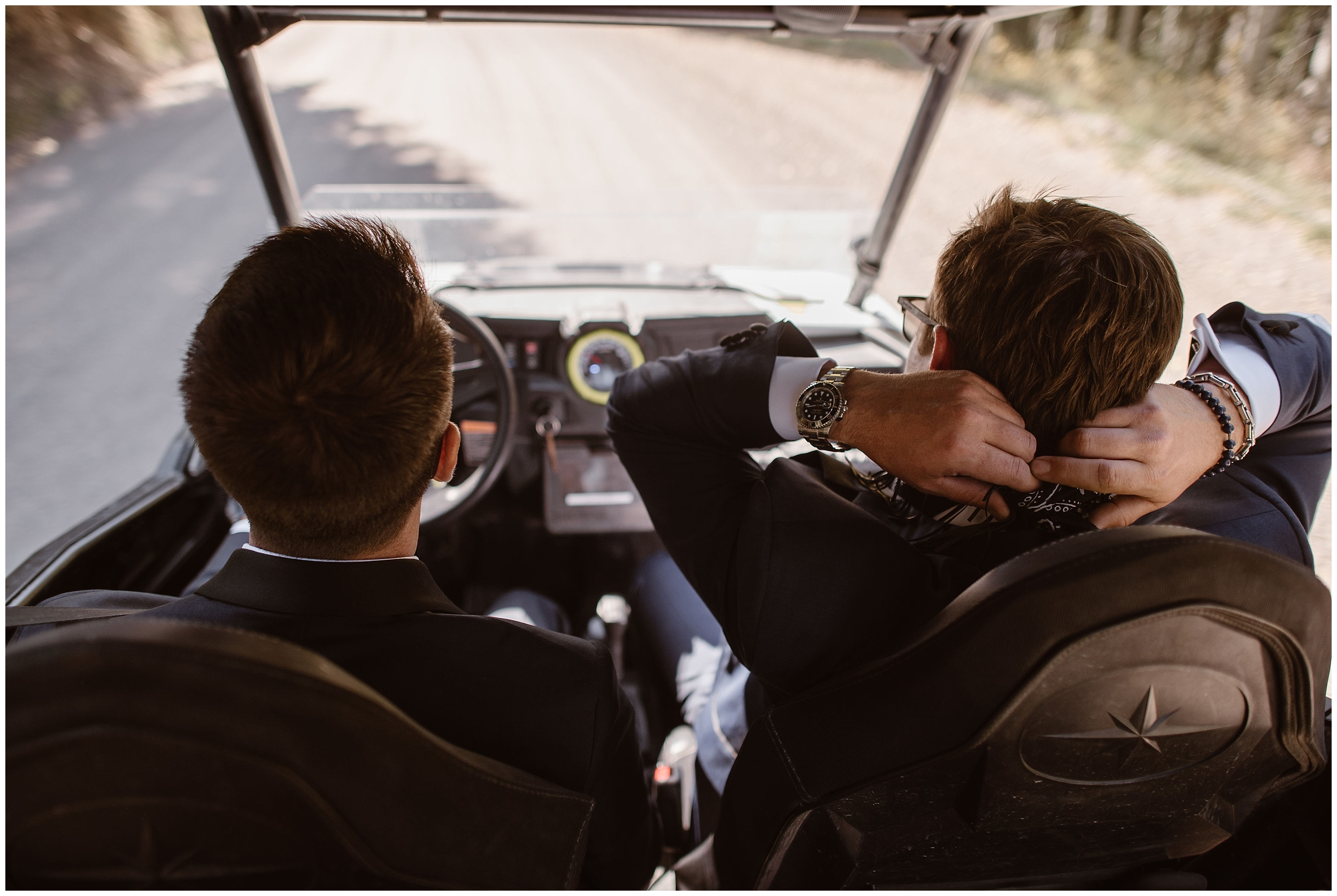 Brian and Ernie, the two grooms, sit in the front seat of their off-road vehicle as they head up in their side-by-side to their 4x4 elopement. The elopement ceremony location that Brian and Ernie chose was near and dear to their hearts.