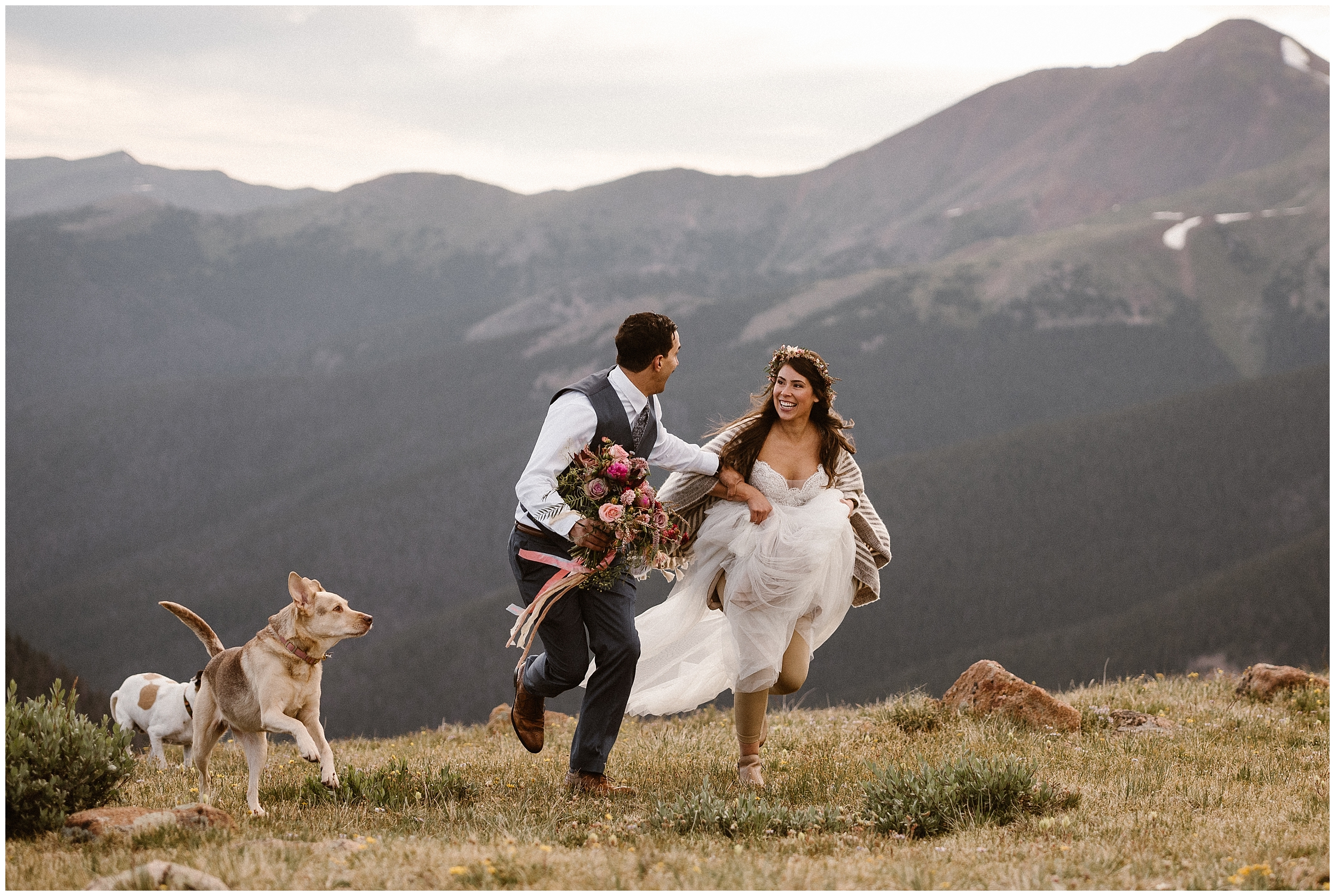 A bride and groom run through a mountaintop meadow as their two pups sprint alongside them during their elopement wedding ceremony. Including your dog in wedding ceremony is one of the meaningful, unique eloping ideas you can include in your adventure elopement.