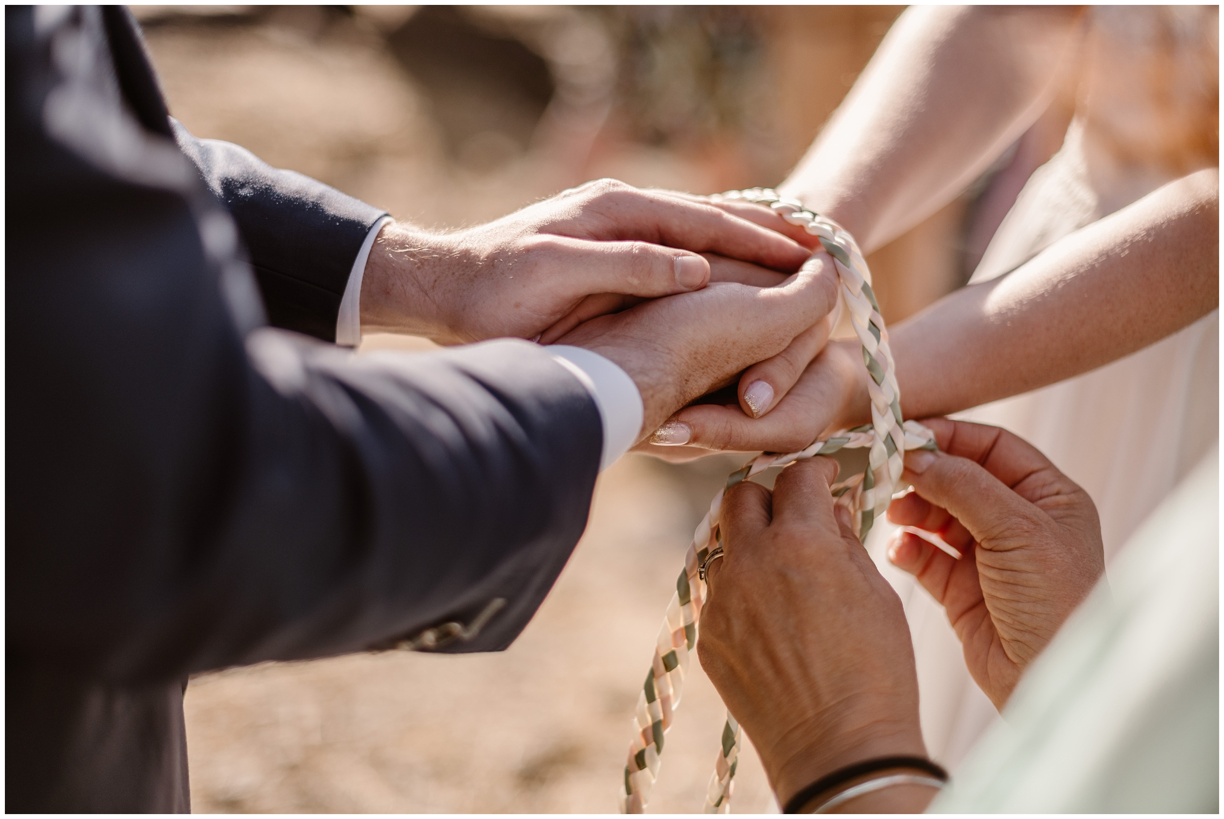 This close-up shot (captured by Oregon elopement photographer Adventure Instead) shows the officiant tying a cord around Lauryn and David's hands. This handfasting ceremony is one of the unique eloping ideas that the bride and groom wanted to include in their Columbia River Gorge elopement.