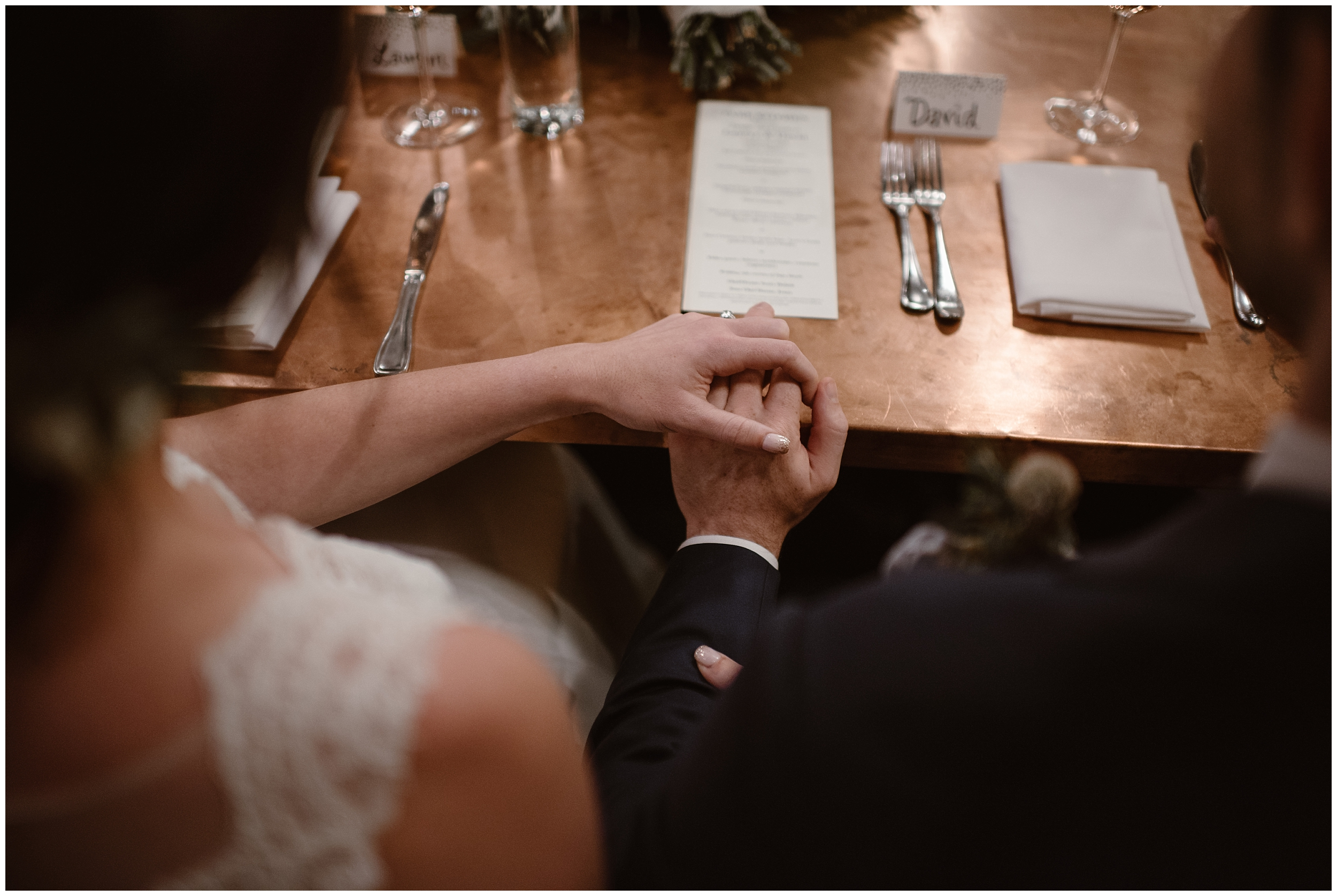 Lauryn and David take hands during their reception after eloping at a Portland restaurant. Their elopement ceremony, held in the Columbia River Gorge, was just the first portion of their Oregon elopement experience.
