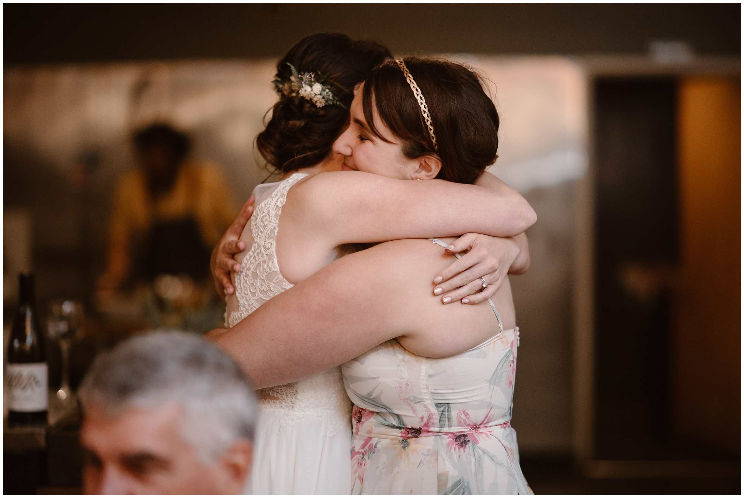 Lauryn , the bride, hugs a wedding guest at a Portland restaurant during the party after eloping.
