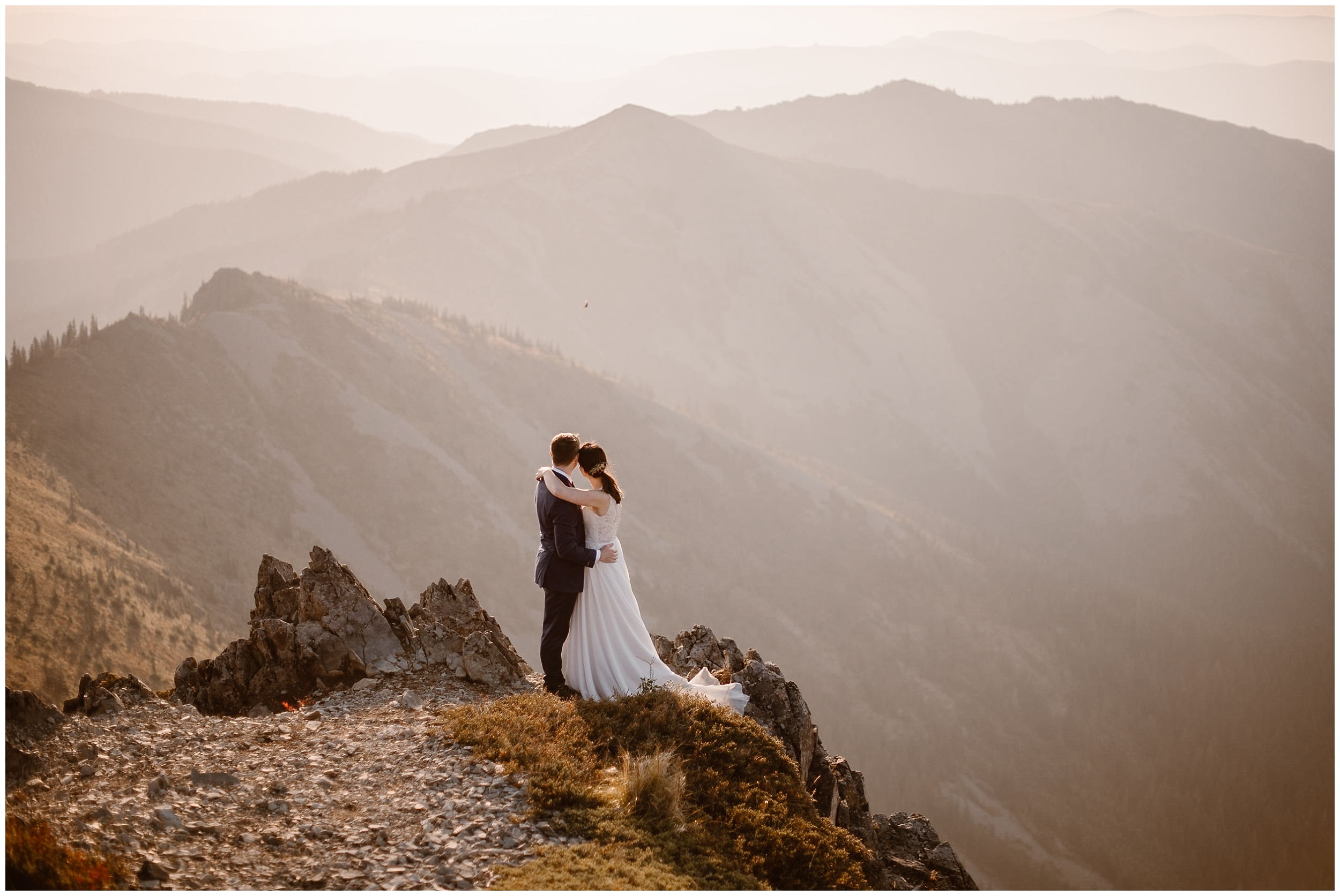 Lauryn and David hold each other close as they look out from the top of the mountain in these elopement photos captured by elopement photographer Adventure Instead.