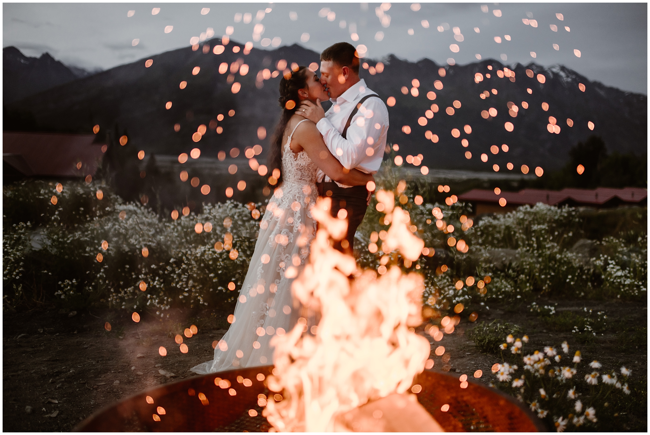Jordyn and Connor, the bride and groom, hold each other close during their first dance next to an Alaska campfire. They chose to elope for a just us day all by thesmelves in Alaska, exploring glaciers during their elopement ceremony and finding the best elopement locations.