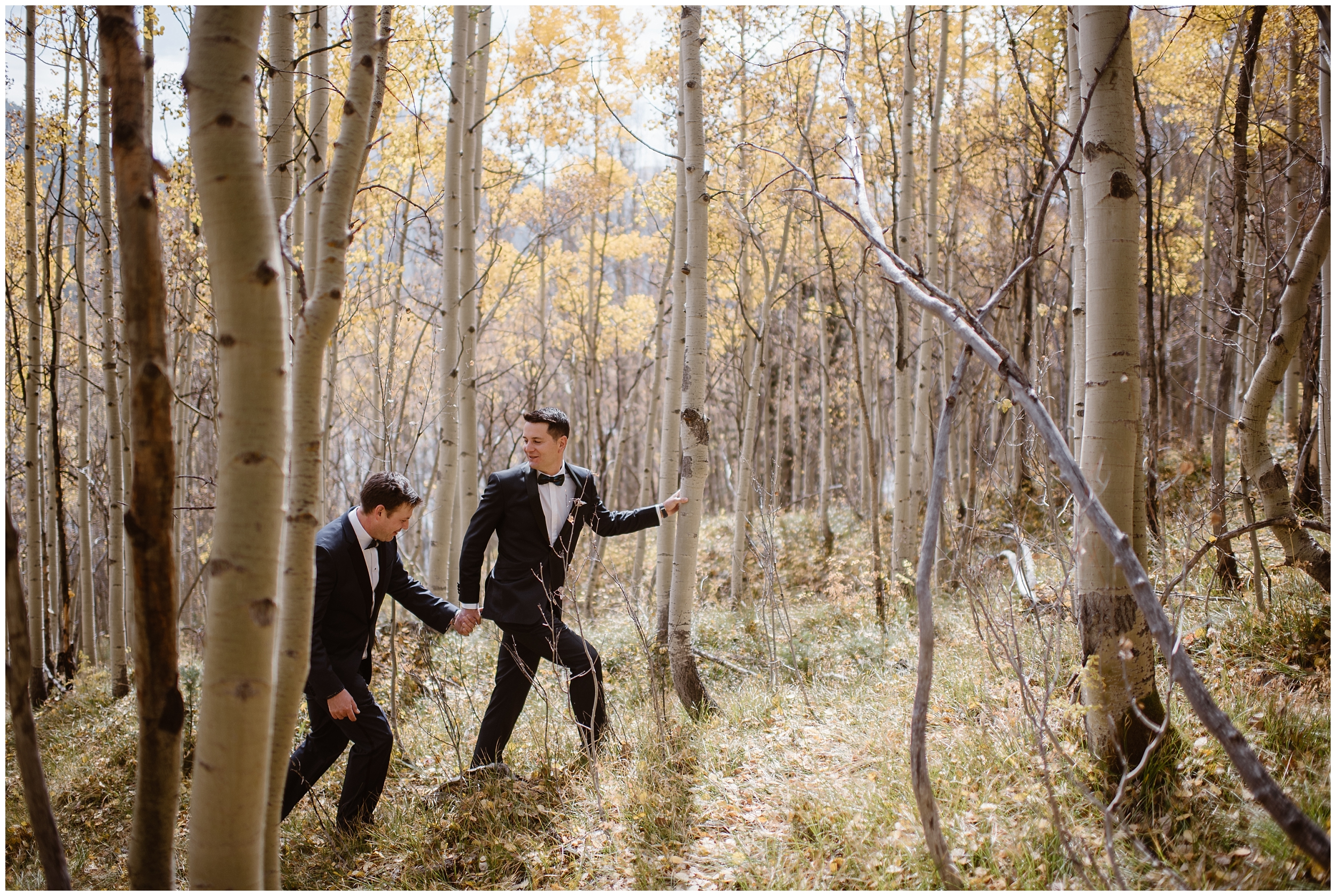 Brian and Ernie, the grooms, traipse through an aspen forest during their Colorado mountain elopement. This LBGTQ wedding was held in Ouray, Colorado and Brian and Ernie were able to implement all their unique eloping ideas into their elopement ceremony. They even eloped with immediate family!