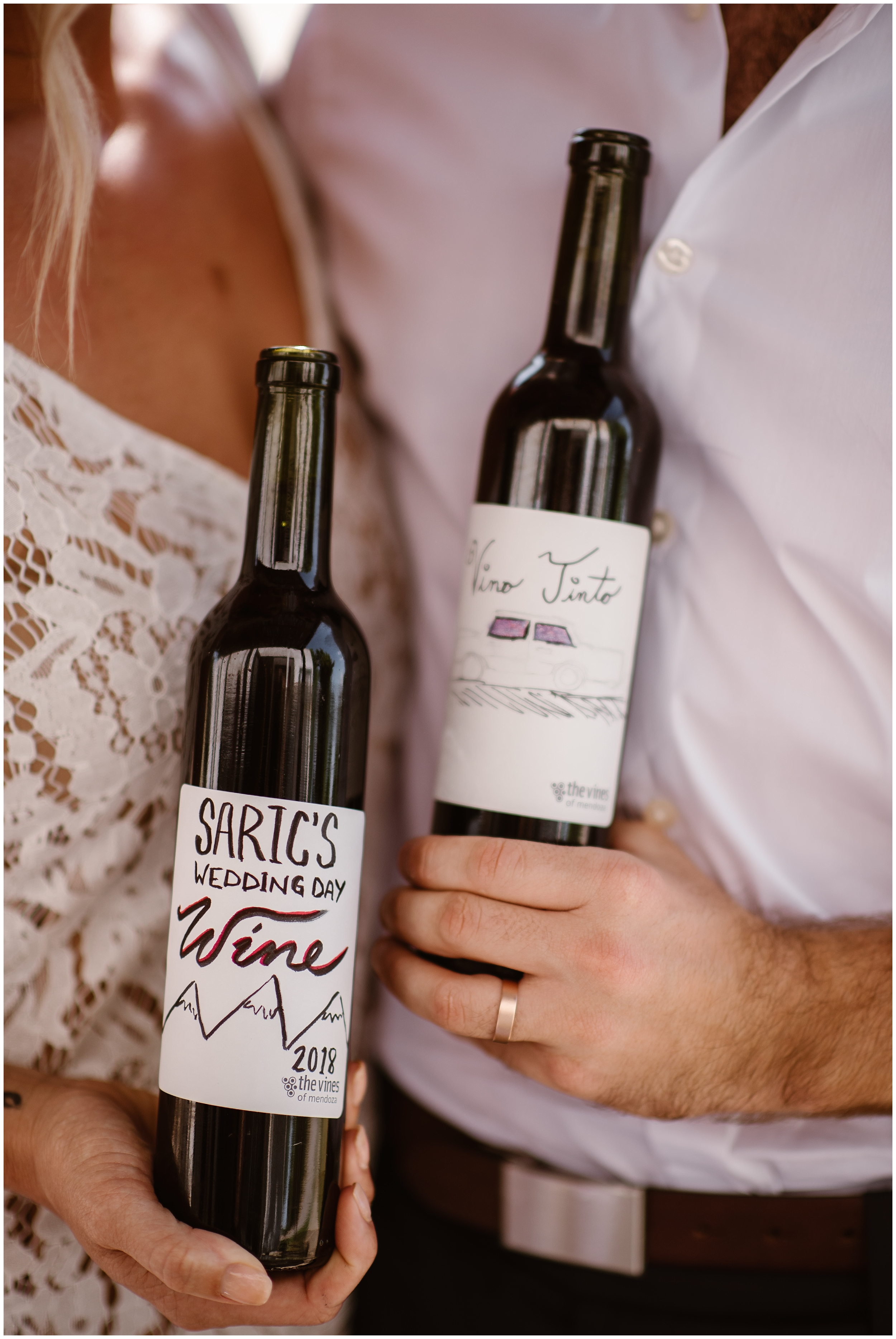 This adventure elopement photo shows a close up of the wine that a bride and groom made on their elopement day . They willl bring thsi special blend home to their family to share with them as a way to include them in their elopement.