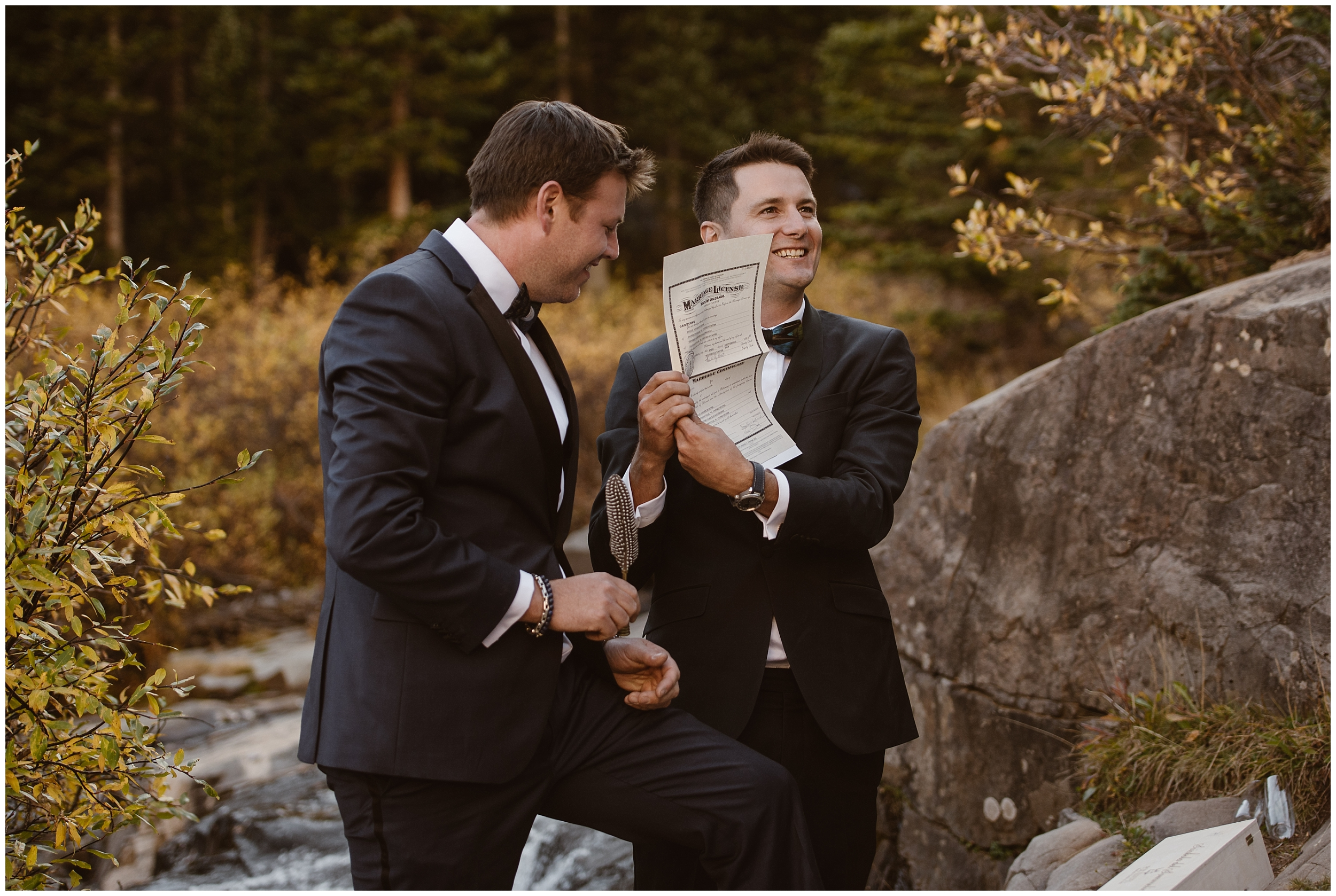 Two grooms hold up their marriage certificate license (which they signed during a wedding ceremony where they inclued their familly). These lgbtq wedding photos were captured by Adventure Instead, an elopement wedding photographer.