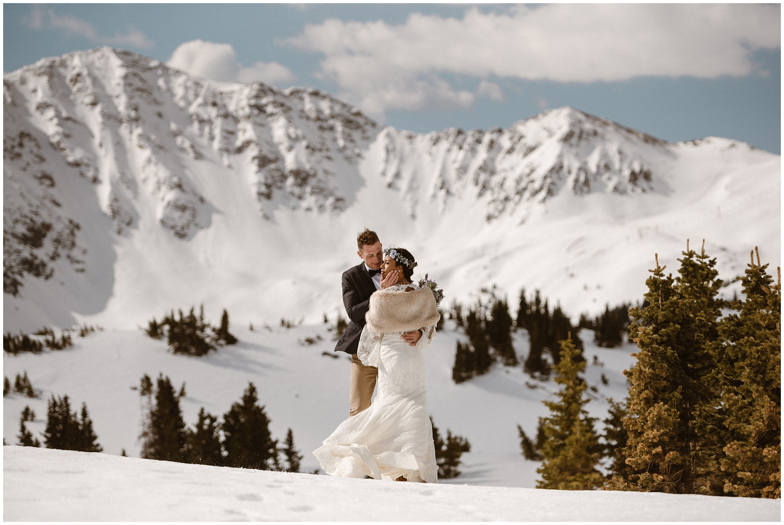 A bride and groom hold each other close in a snowy, alpine environment. This Colorado Mountain wedding was everything this couple wanted for their unique destination elopement.