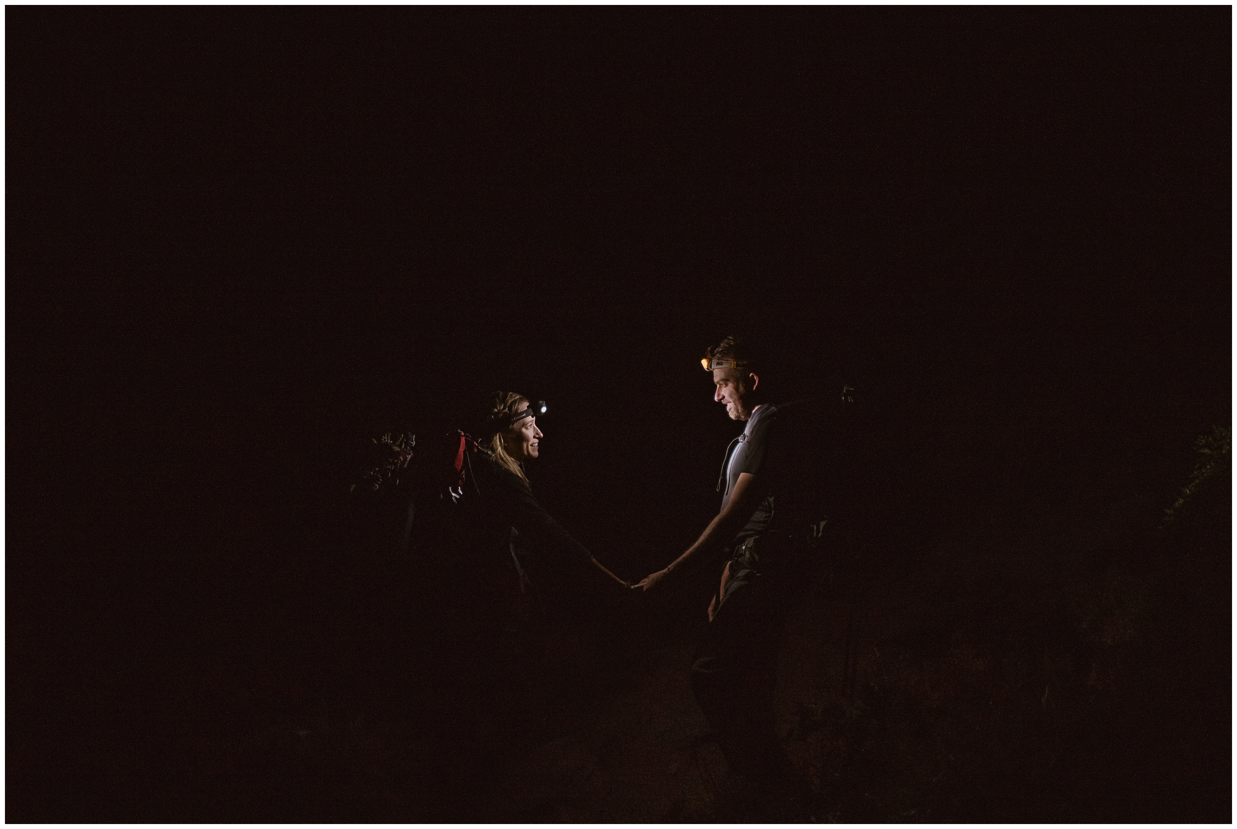 Brecka and Nick chose to elope in the way that meant the most to them — by having an adventure hiking elopement. Brecka and Nick's Colorado mountain wedding was all about them, their unique eloping ideas, and each other. In this elopement photo captured by Adventure Instead, Brecka and Nick take hands in the dark, lit up only by their headlamps.