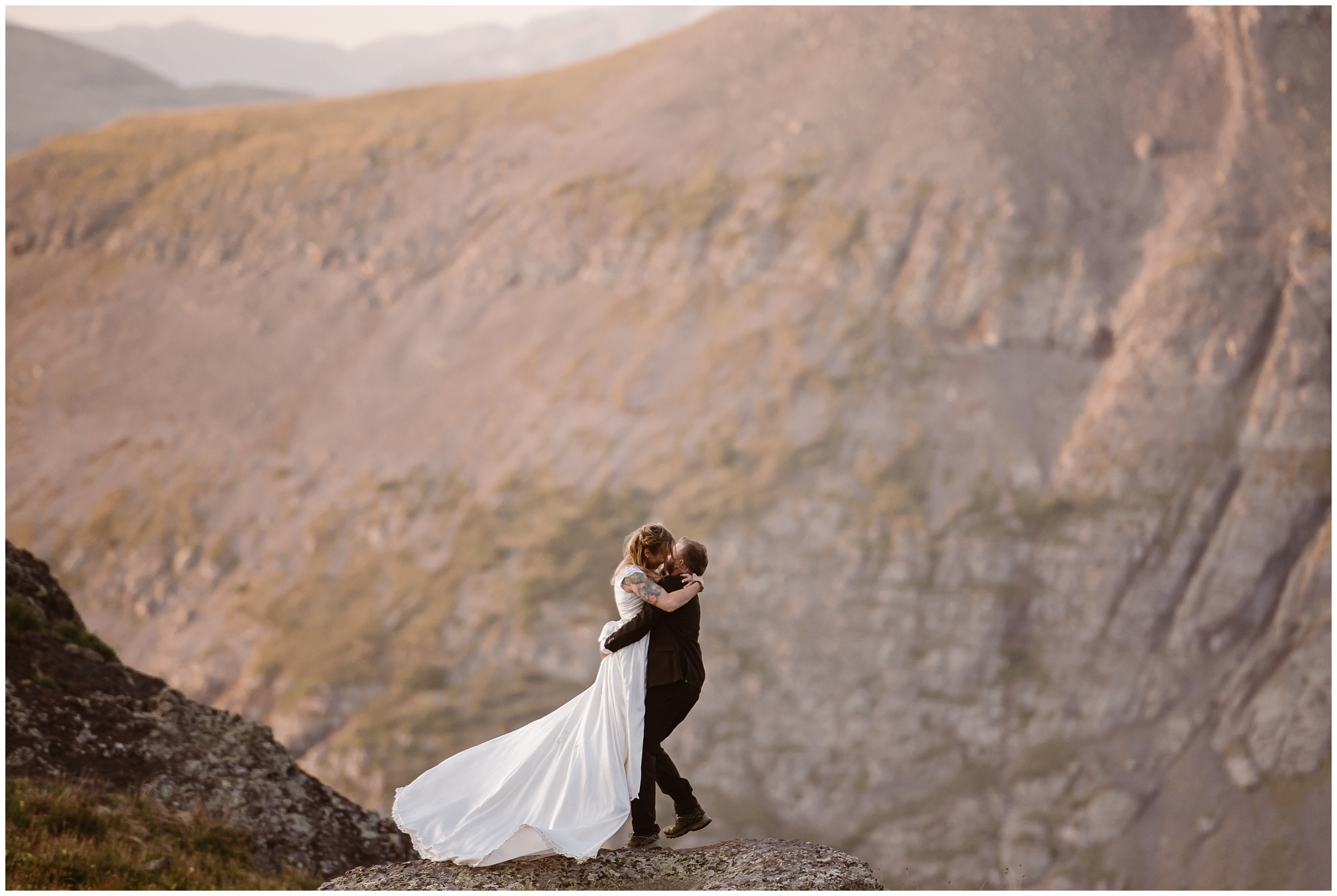 Nick embraces Brecka and picks her up in front of an epic view of an Ouray, Colorado mountain range. The two chose this adventure elopement because they wanted a Colorado mountain wedding that was perfect for them. The location was their unique eloping idea!