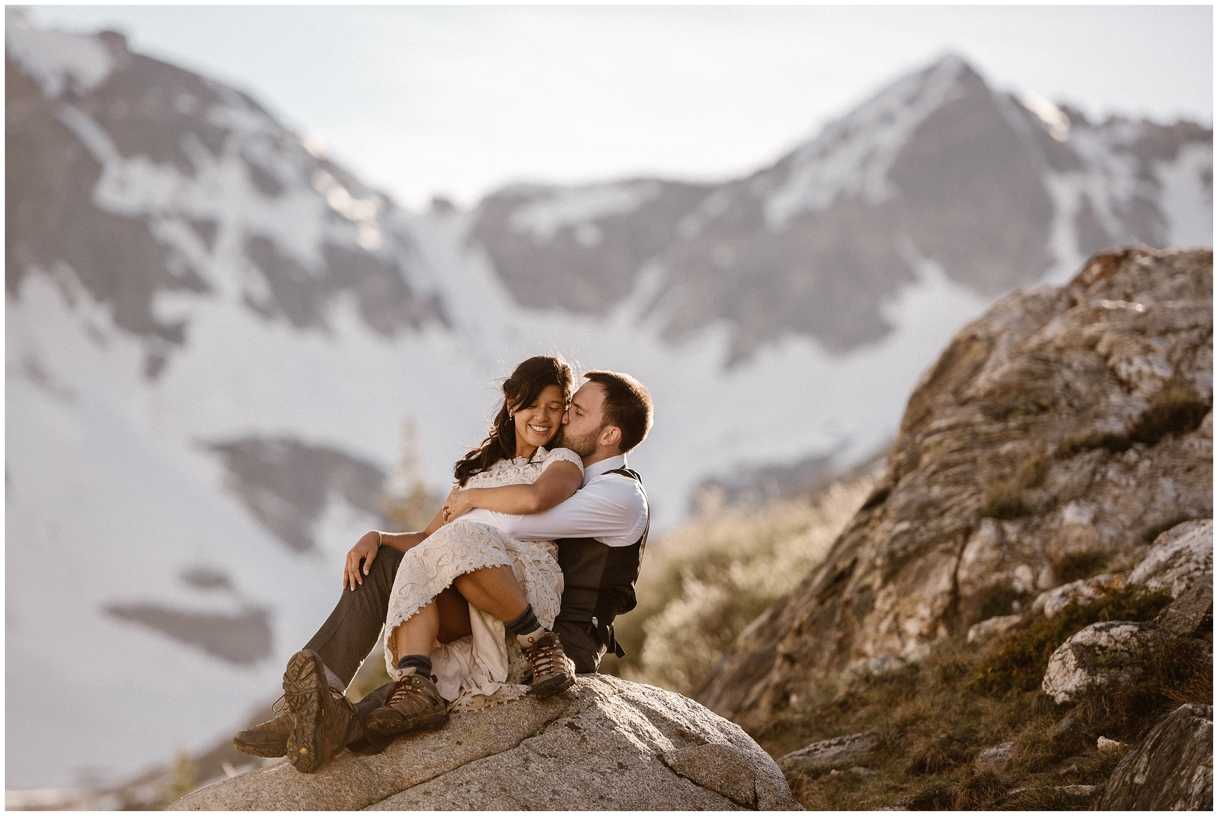 A bride and groom hold each other tight as they sit on a rock right after their elopement ceremony. This destination elopement was the small simple wedding they always dreamed of! Why elope? Because you can create a day that means the most to you!
