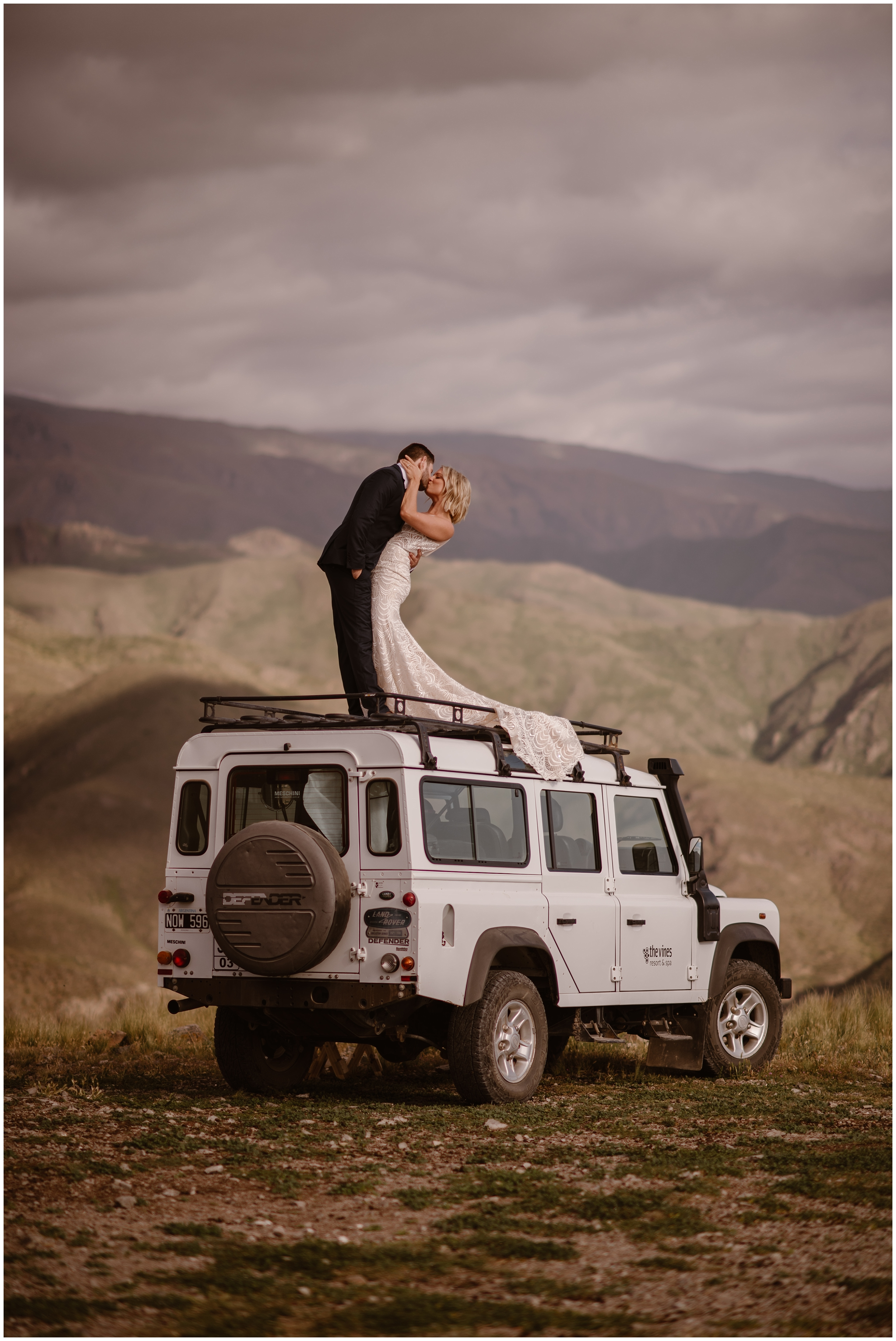 A bride and groom hold each other close and kiss after their elopement ceremony in Iceland. A small simple wedding was exactly what this couple wanted, and having it in Iceland was a way they incorporated their unique eloping ideas into their big day. These adventure elopement photos were captured by elopement wedding photographer Adventure Instead.