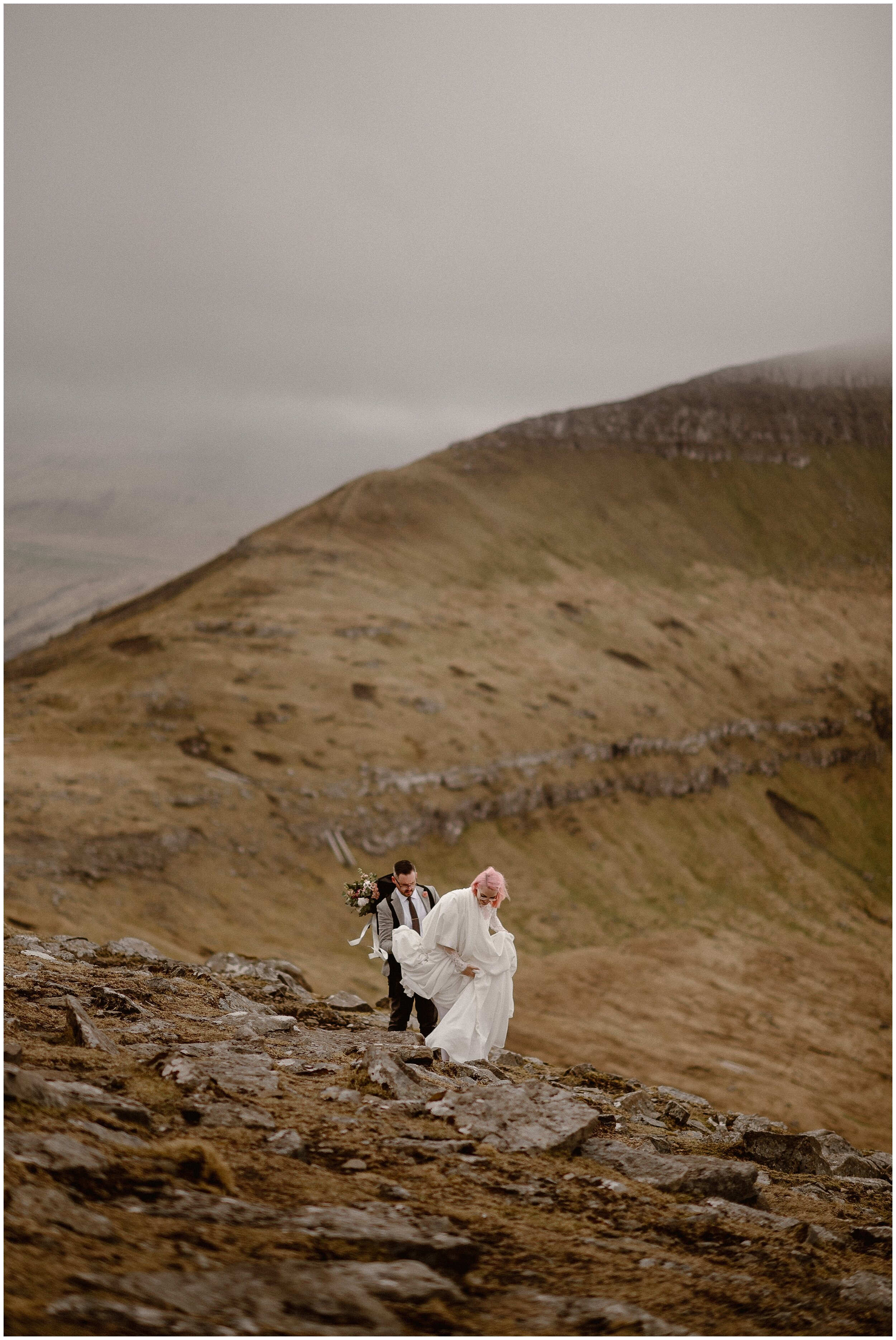 Elaura and Daryn begin the trek up to their hiking elopement in the Faroe Islands. These adventure elopement photos were captured by Adventure Instead, an elopement wedding photographer.