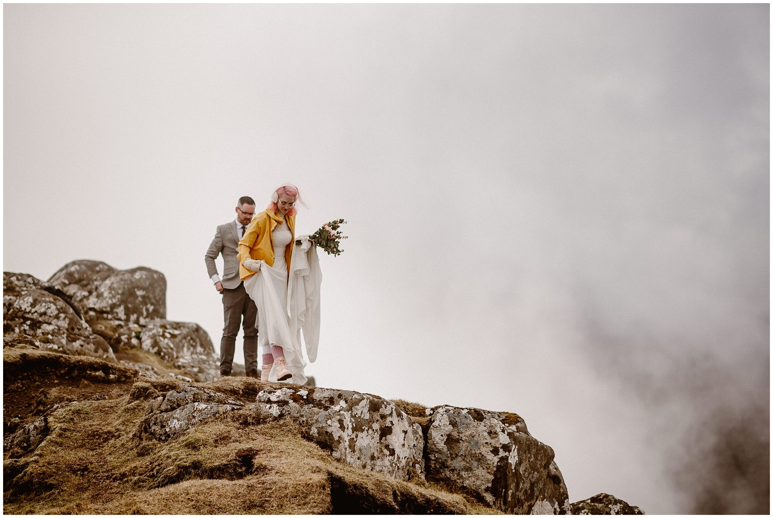 Elaura and Daryn begin the hike up to their Faroe Island destination elopement ceremony at the top of a Faroe Island mountain. These adventure elopement photos were captured by destination wedding photographer Adventure Instead.