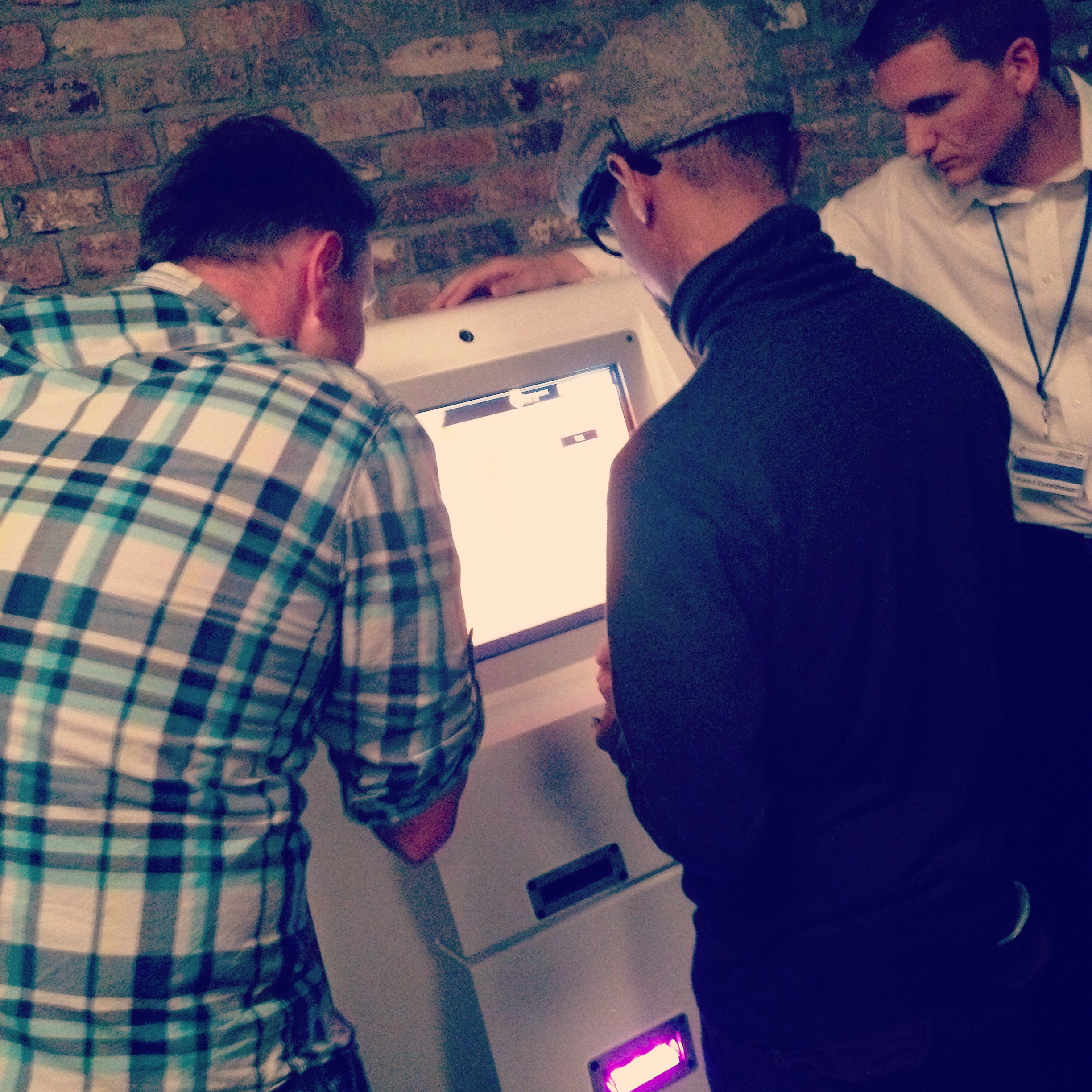 Exchanging cash for Bitcoins using my smart-phone at the unveiling of a Bitcoin ATM.