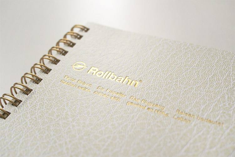 Faux-leather cover is debossed with gold text.
