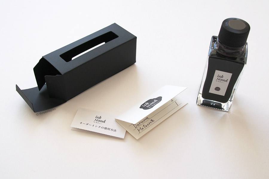 "Each bottle comes in a minimal, black paper box with cut-outs on 2 sides. Inside is a little ""how to use"" info card and custom color recipe card that has your ink serial number you can use to reorder the ink."
