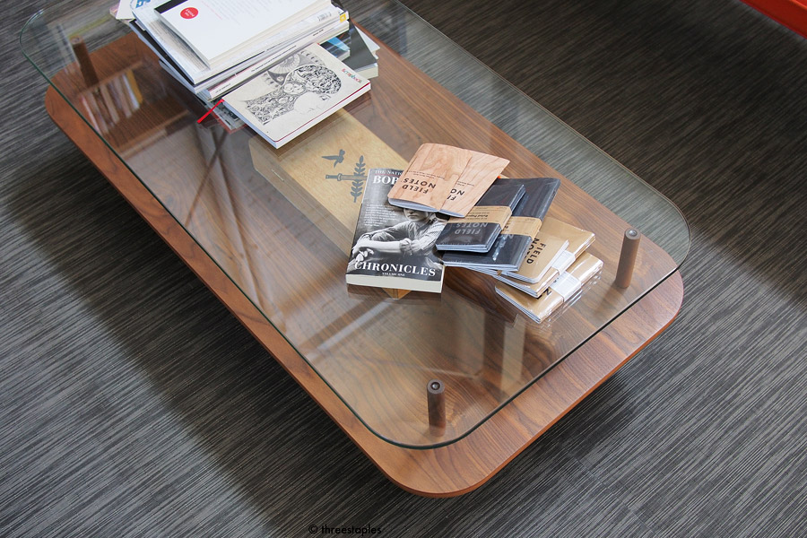 Some books and current standard offerings on top of a gorgeous coffee table.