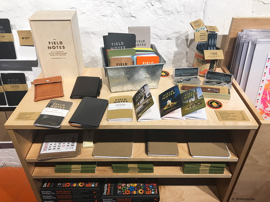 Table full of samples, including  Campfire  (latest quarterly edition),  Everyday Inspiration , and the newly-improved  Daily Carry Memo Book Cover .