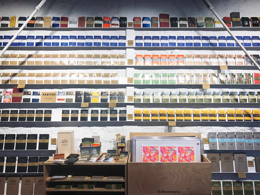 """I want this wall at my place. Notice all the quarterly editions that have ever been released lined up on the top """"Not for Sale"""" shelf. Bryan said they're going to need more shelf space for future releases!"""
