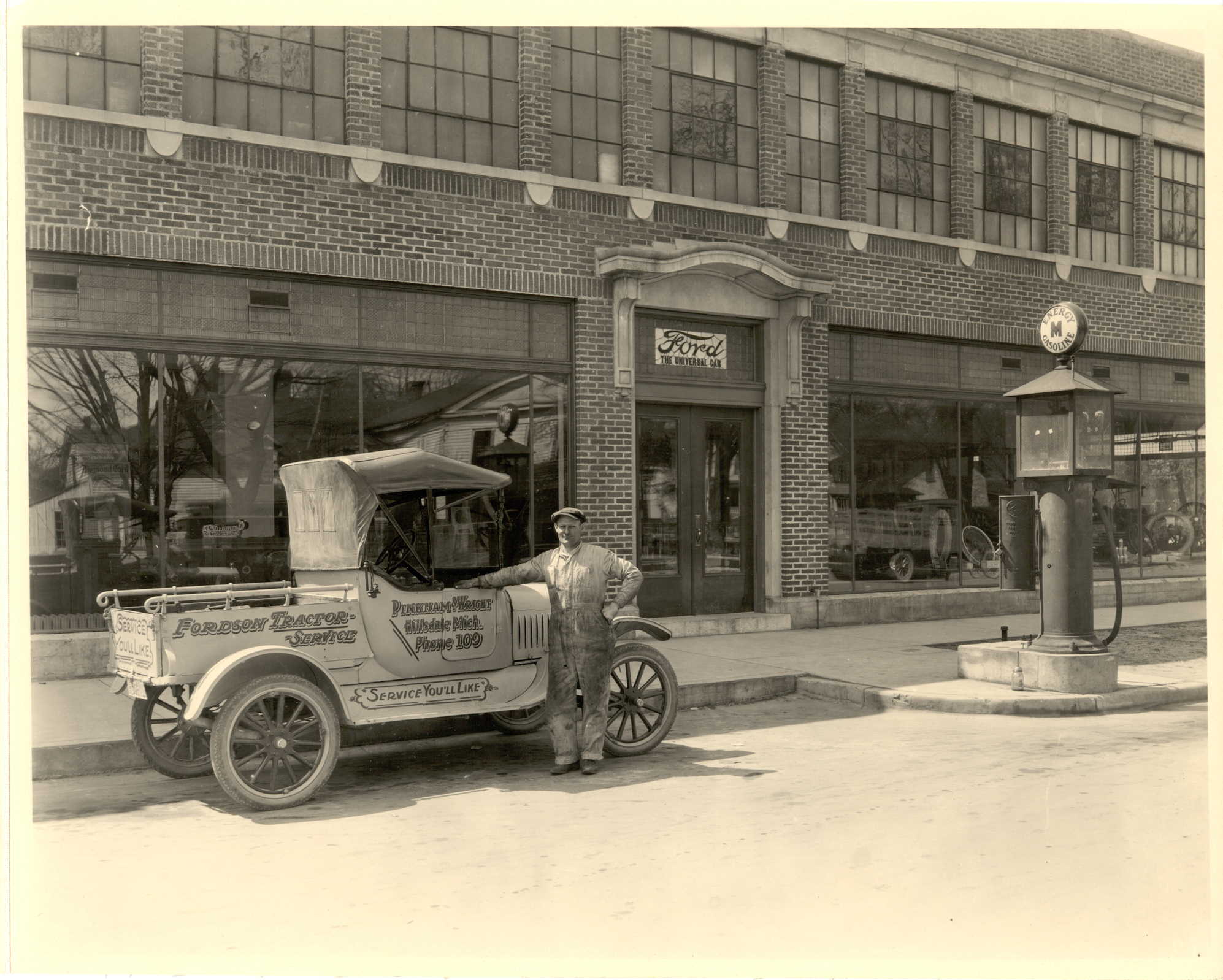 the Pinkham and wright ford dealership on Manning Streetin Hillsdale had a gas pump in front.