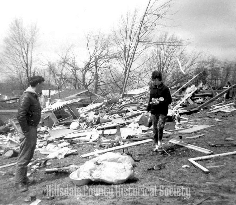 an unidentified couple sift through what little remains of their belongings at bear lake.