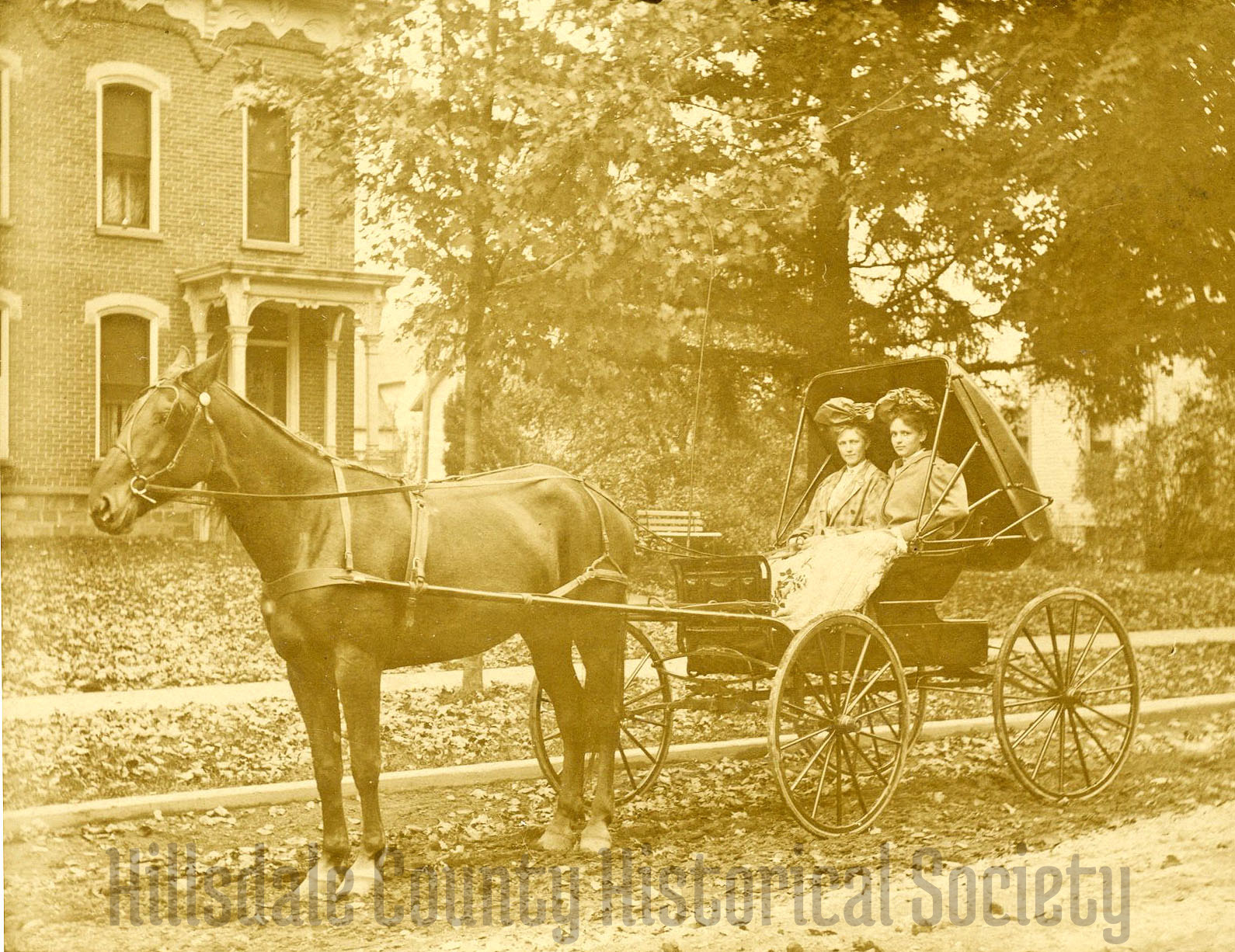 carrie mallory with her sister in front of their Italianate home on michigan street