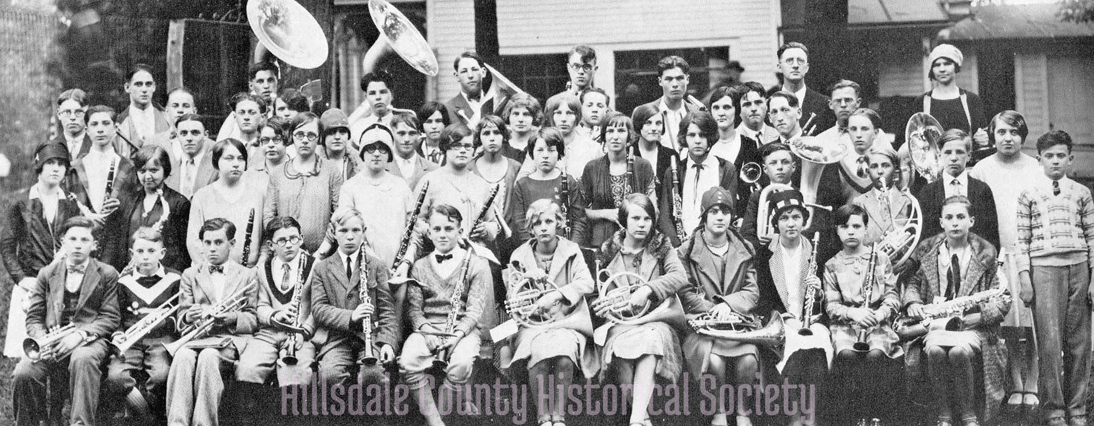 The 1928 Frontier High School Band at the side of the fair office (which is now the hillsdale County Historical Society museum)