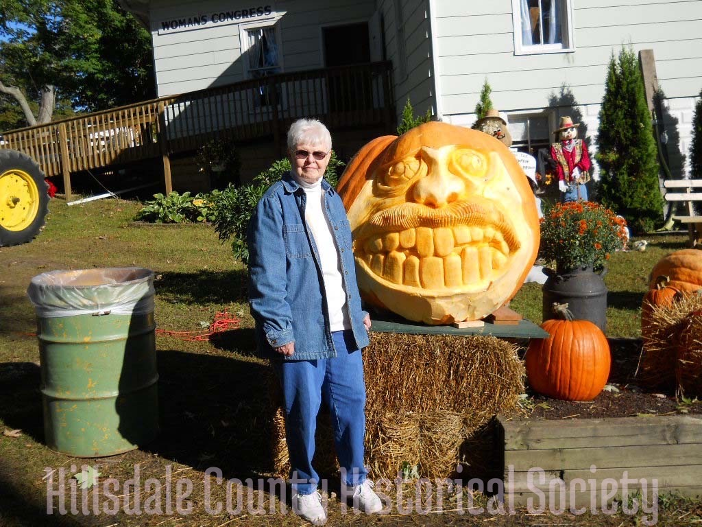 a smiley face carved into a huge pumpkin is one of the novelties you can see at the fair