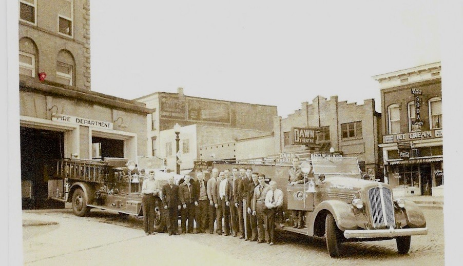 In this undated photo the Seagrave is shown closest to the fire station at city Hall. (photo donated by dan bisher)