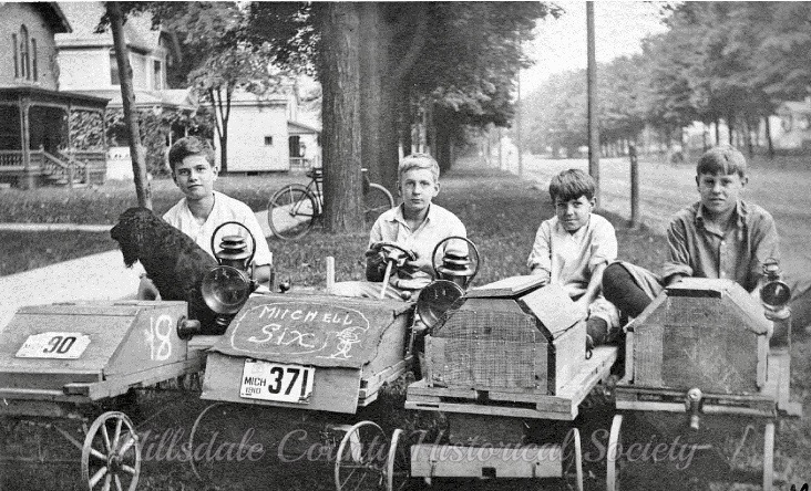 bill frankhauser, dean stock, frederic stock and dick walworth line up in their neighborhood on broad street. the identity of the canine is unknown.